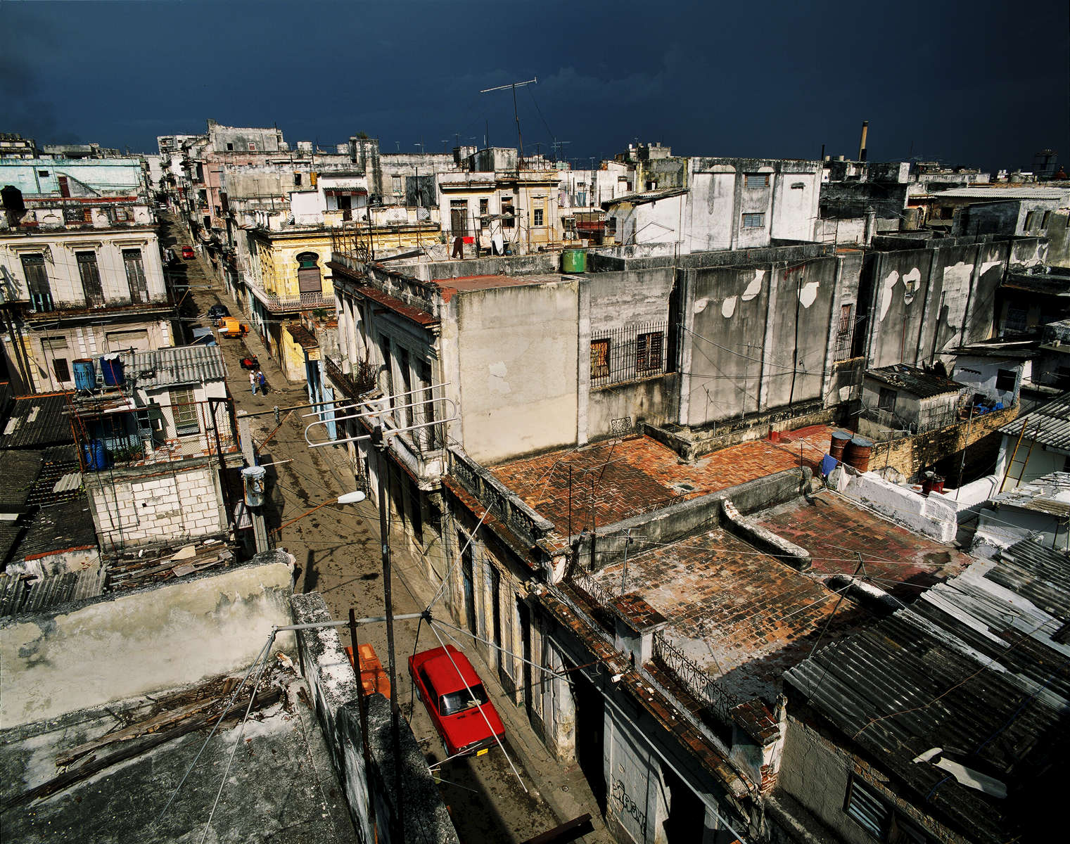 From Eduardo's roof, while enjoying the sunset, before the storm, over a bottle of rum, overlooking the mix of revelutionary and pre-revolutionary architecture.Havana, Cuba