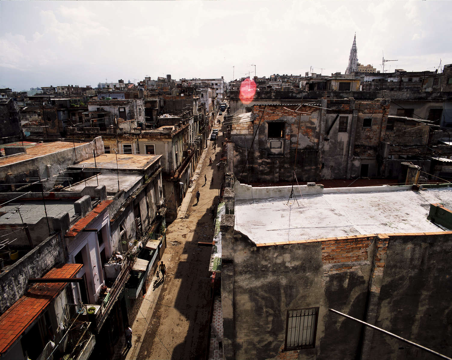 The sun sets over the rooftops of Barrio Chino (China Town) and Centro Habana. Havana, Cuba