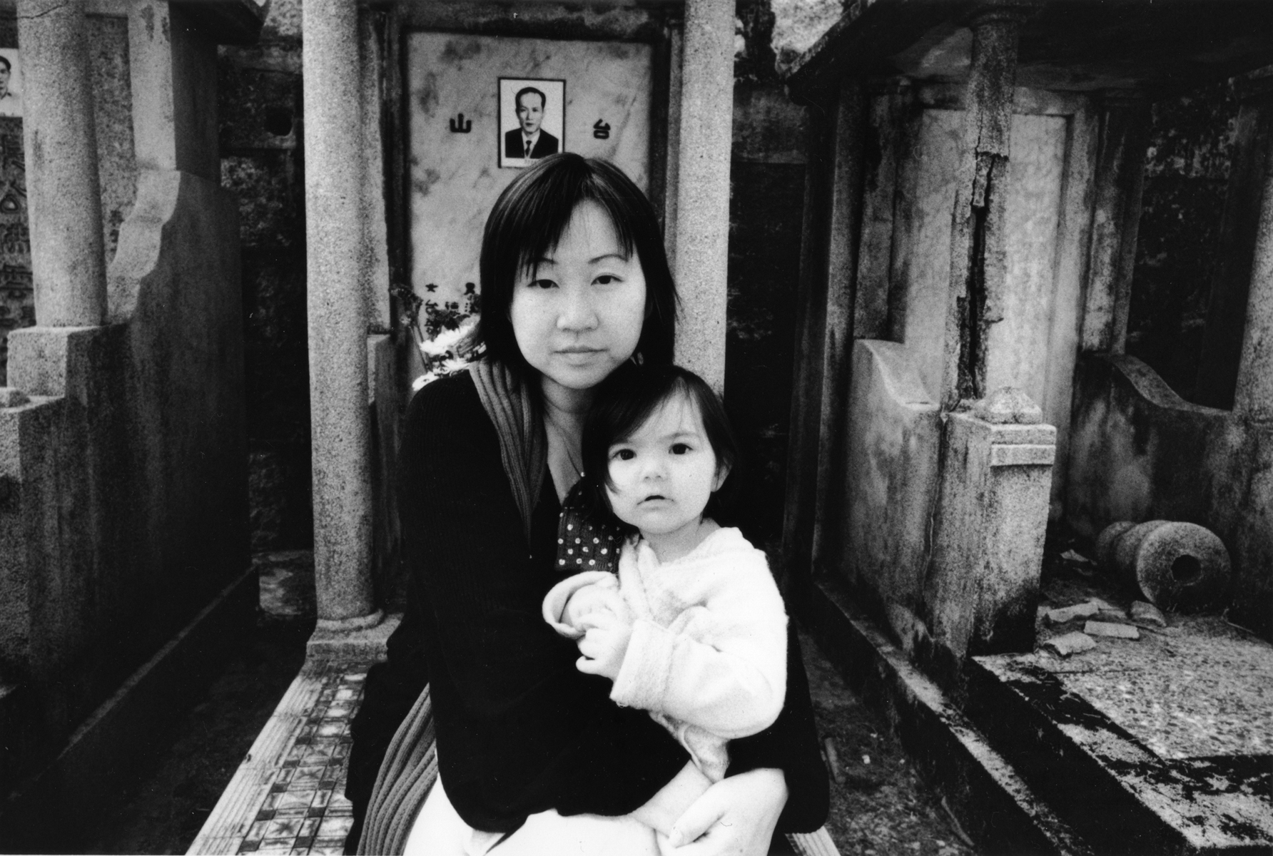 Chi Ying pays respect to her father, Cheung Chiu Lee, with her daughter at the Cheung Sha Wan Catholic Cemetery.Hong Kong Island