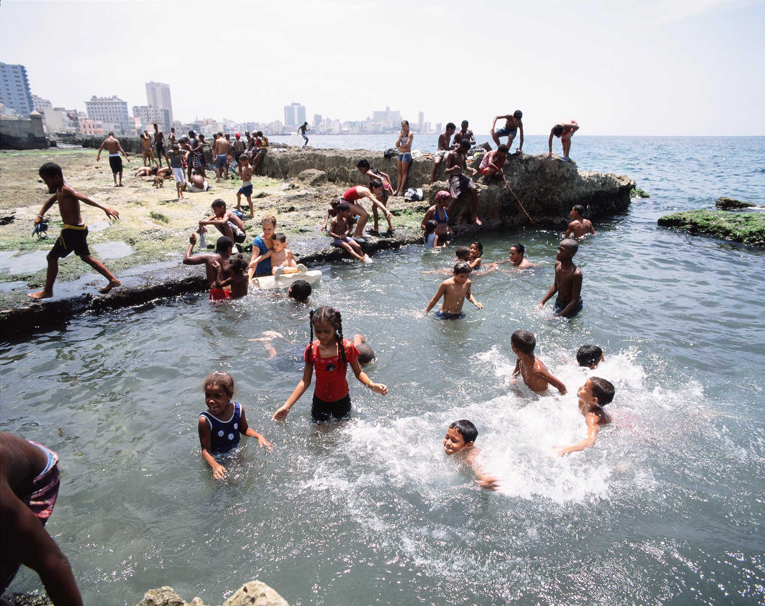 As summer begins to heat up, Enmauel, Hamilie, their younger sister, and their cousin, Gretchel, enjoy a day of swimming at the Malecon.Malecon, Havana, Cuba