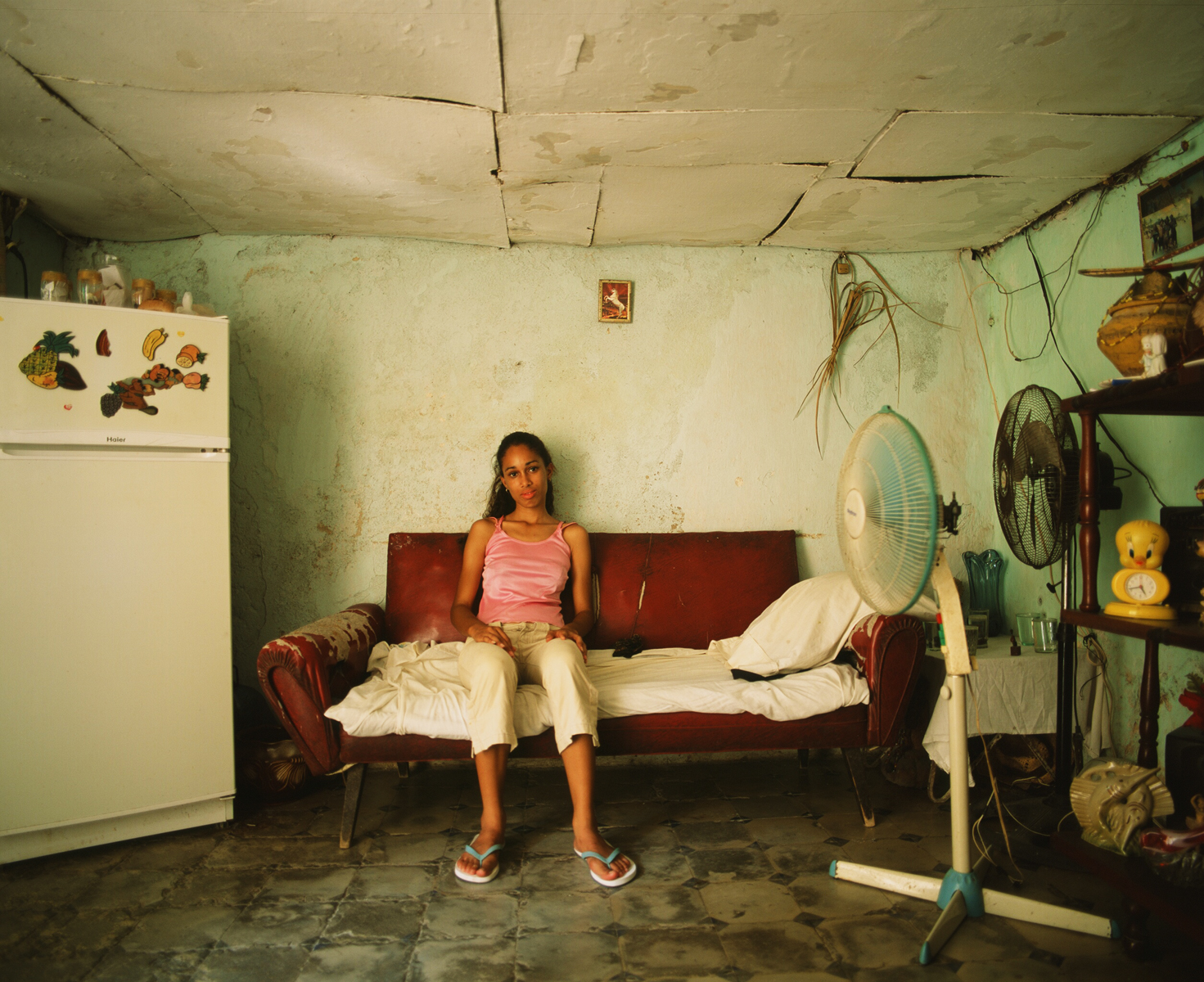 Elsa's granddaughter poses for her portrait in their home. Havana, Cuba
