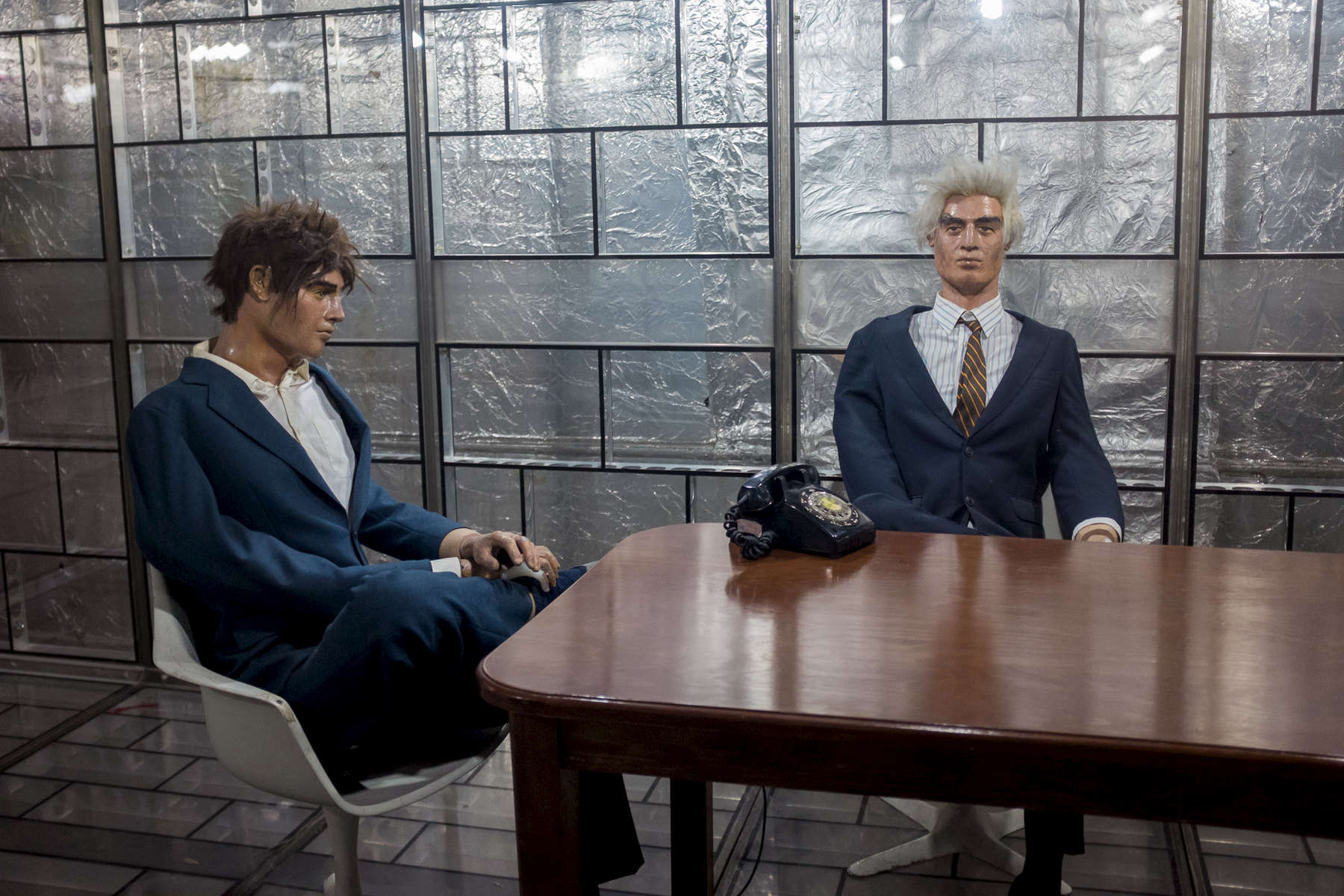 Wax figures representing former US embassy staff inside the so called 'Glassy room for secret negotiations' in Tehran.