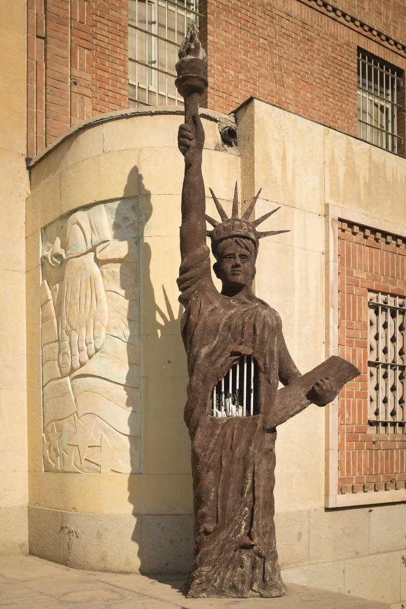 A statue guarding the entrance to the former US embassy. Dubbed by the Iranian government as the 'US Den of Espionage', the building is now home to hardline defenders of the Revolution, the 'Sepah militia', and is used as a training ground for the Revolutionary Guards.