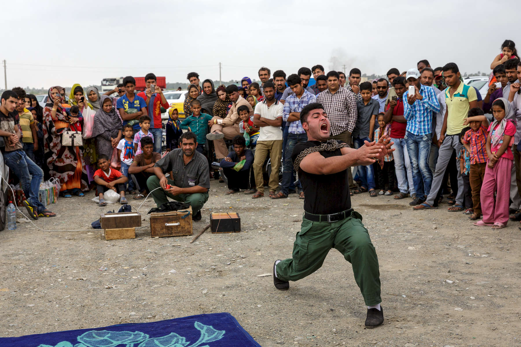 A strongman theatrically struggles to break free of chains in Minab, Southern Iran.  His performance could be considered something of a metaphor for the general feeling encountered in the country; which was that of a people desperate for greater opportunities and freedoms denied by the current government.