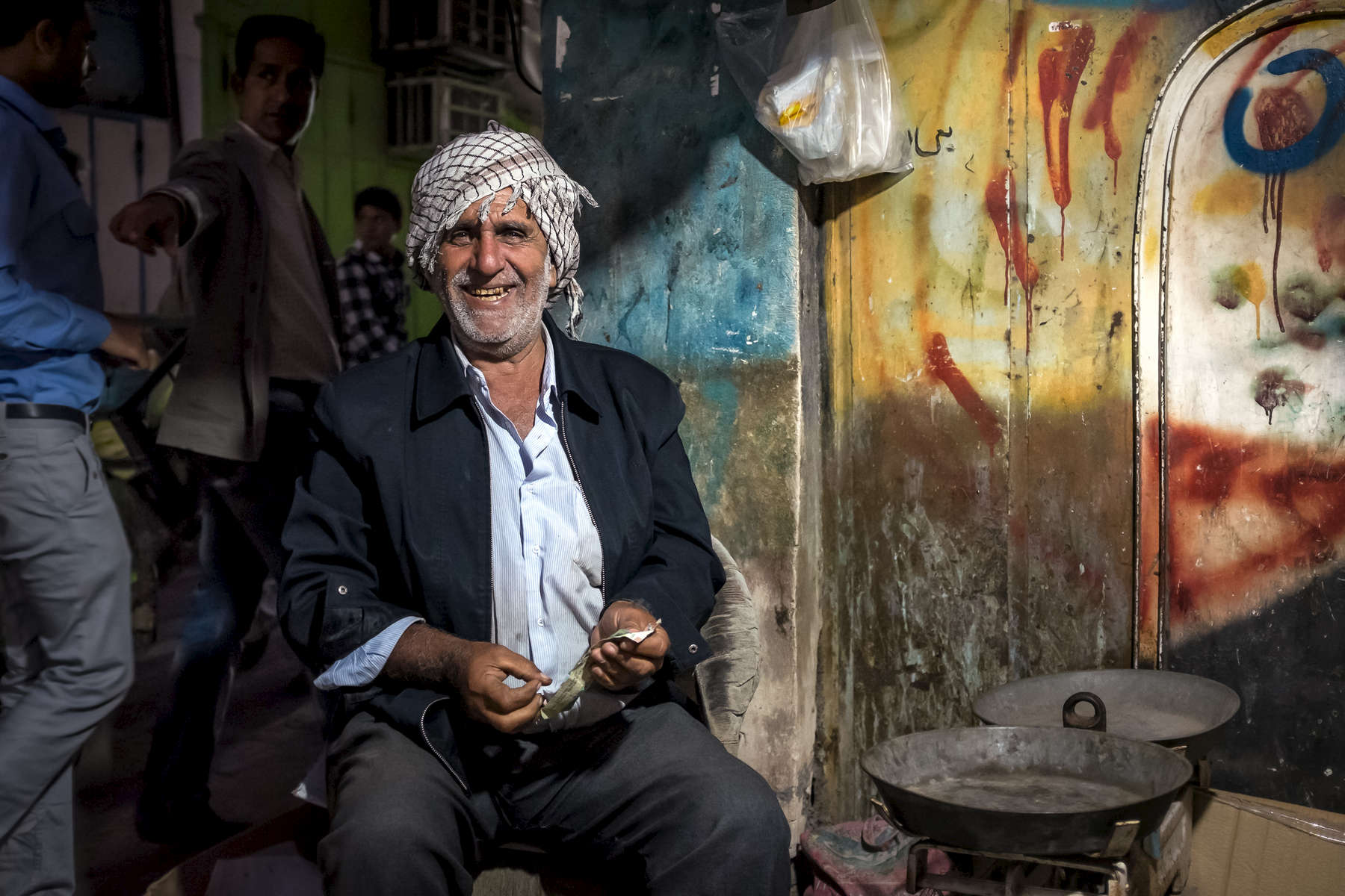 A fruit salesman in Bazar e Zytoon, Bandar Abbas.  His large smile may have been at the ease a hungry photographer was overcharged for a bunch of bannanas.