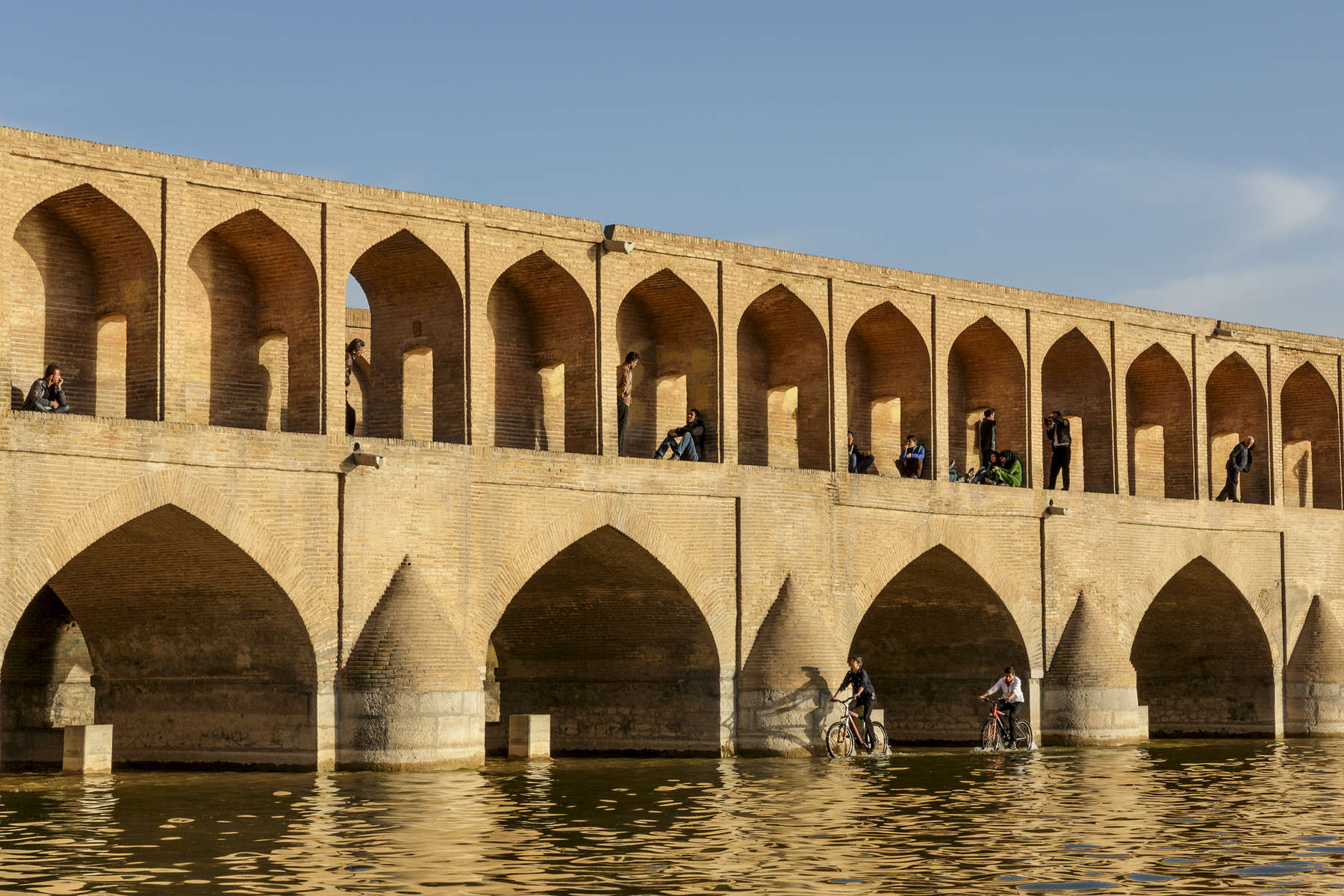 Sunset at Khaju Bridge in Isfahan.  The bridge and banks here are a popular meeting place for local families.
