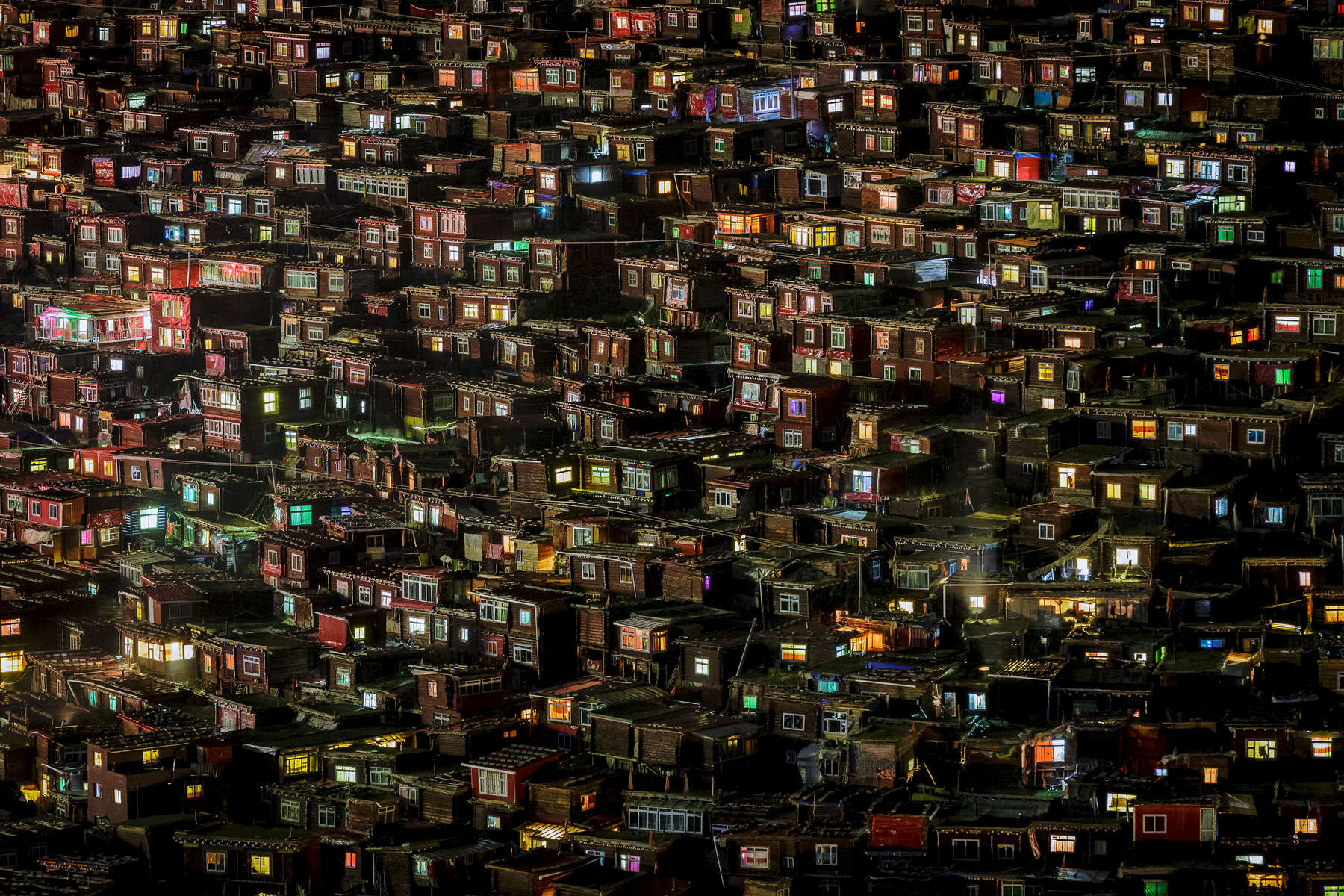 The surreal Larung Gar encampment at night.  The couloured glass or plastic windows of the huts make for an impressive sight as night falls.