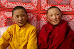 Two young nuns relaxing outside the main temple late afternoon.