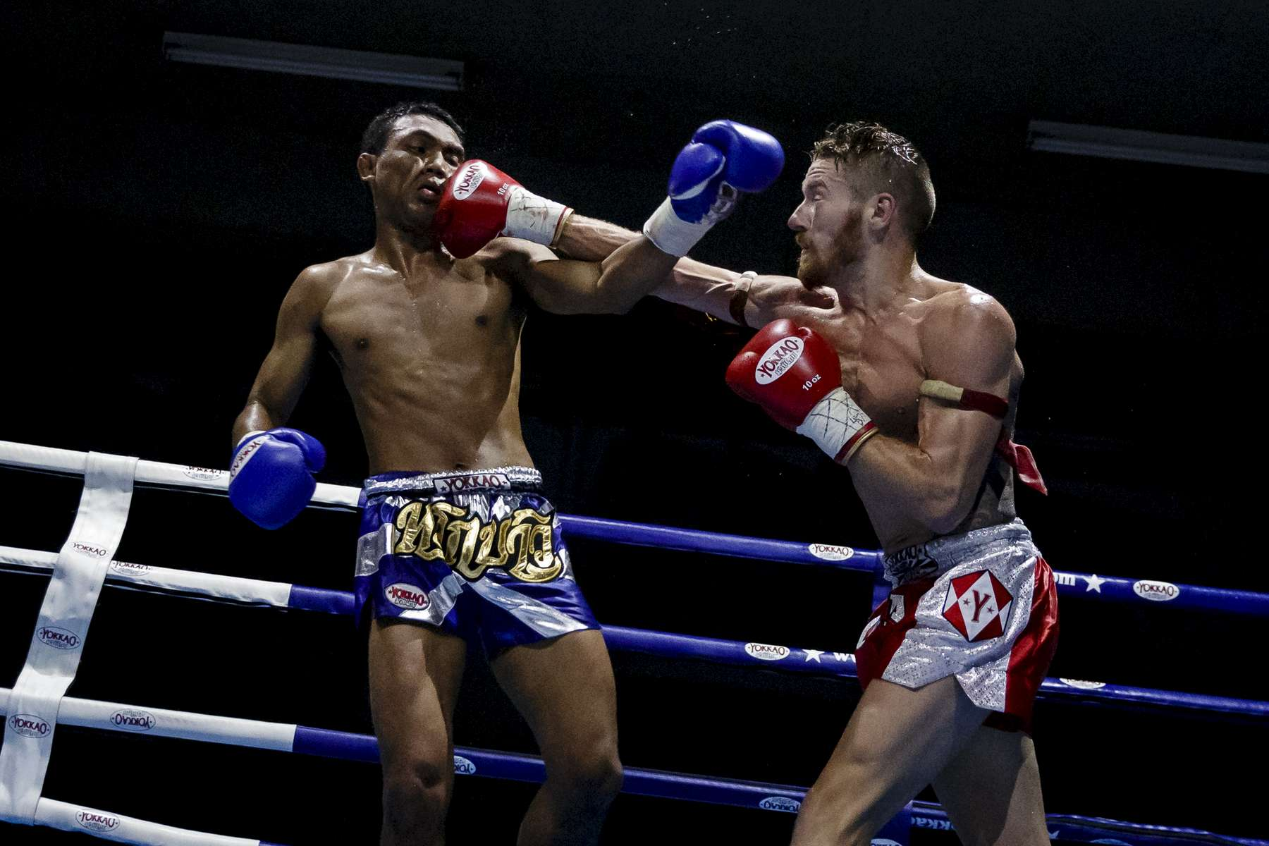 SYDNEY, NEW SOUTH WALES - MAY 21:    Gary Patterson strikes Phisit Suksawang during their professional Muay Thai bout at the SRG Thai Boxing Gym on May 21, 2016 in Sydney, Australia.  (Photo by Brook Mitchell/Getty Images)