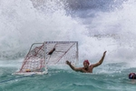 SYDNEY, NEW SOUTH WALES - MARCH 09:  The Olympic Aussie Sharks team goal is swamped by a huge wave during their match againt an International All-Stars team at Water Polo by the Sea at the iconic Bondi Icebergs on March 9, 2017 in Sydney, Australia.  (Photo by Brook Mitchell/Getty Images)