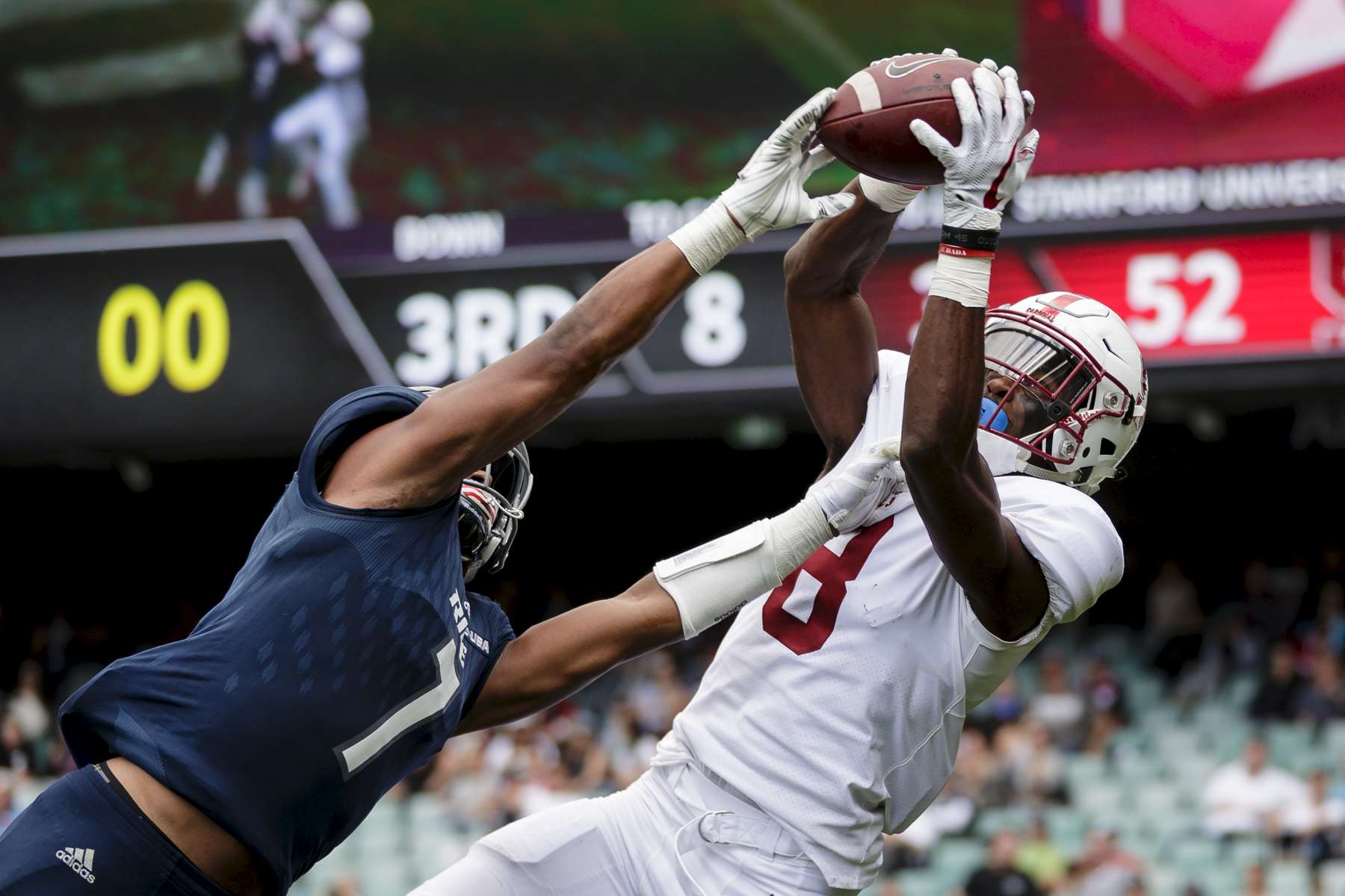 SYDNEY, NEW SOUTH WALES - AUGUST 27: Justin Reid of Stanford catches the ball as Justin Bickham of Rice attempts to spoil during the College Football Sydney Cup match between Stanford University (Stanford Cardinal) and Rice University (Rice Owls) at Allianz Stadium on August 27, 2017 in Sydney, Australia.  (Photo by Brook Mitchell/Getty Images)