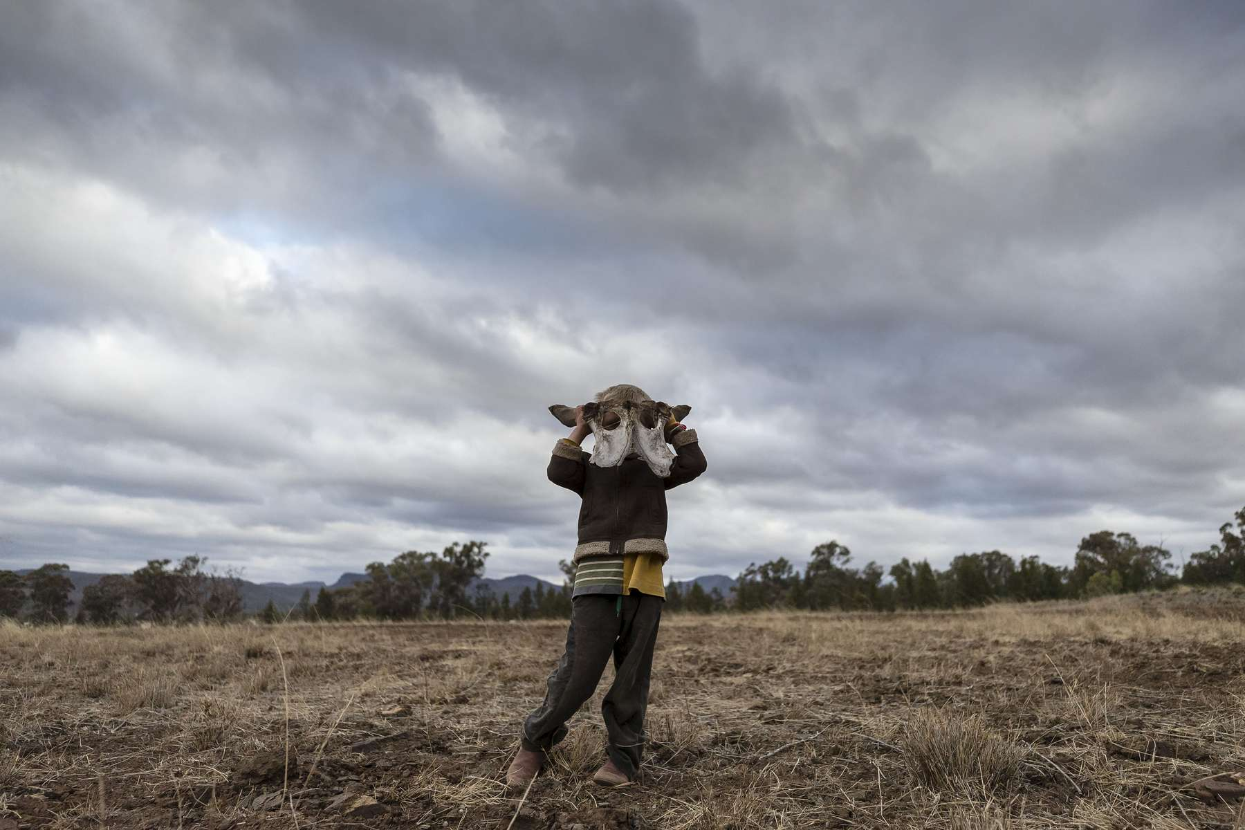COONABARABRAN , NEW SOUTH WALES - JUNE 17:  Harry Taylor,6, wears what he calls his 'monster hat'. The bones of dead livestock have become a common sight on the Taylor family farm during the drought. Asked what he wanted for his recent 6th birthday party all Harry replied was 'rain'. In the Central Western region of New South Wales, Australia, farmers continue to battle a crippling drought which many locals are calling the worst since 1902. In Warrumbungle Shire, where sharp peaks fall away to once fertile farmland the small town of Coonabarabran is running out of water. The town dam is down to just 23% capacity, forcing residents to live with level six water restrictions. The New South Wales State government recently approved an emergency drought relief package of A$600m, of which at least A$250m is allocated for low interest loans to assist eligible farm businesses to recover. The package has been welcomed, though in the words of a local farmer {quote}it barely touches the sides{quote}. Now with the real prospect of a dry El-Nino weather pattern hitting the state in Spring, the longer term outlook for rain here is dire. June 17, 2018 in Coonabarabran, Australia.  (Photo by Brook Mitchell/Getty Images)