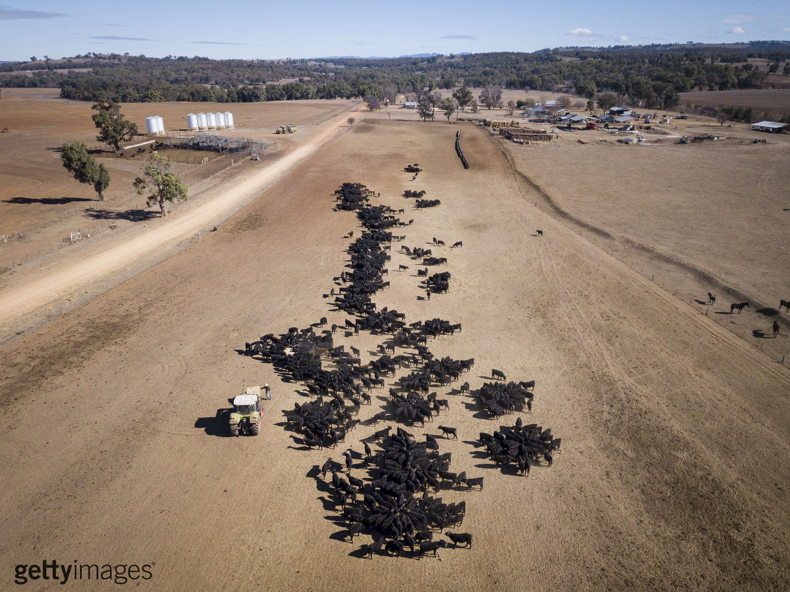 COONABARABRAN , NEW SOUTH WALES - JUNE 19:  An aerial view of the cattle feeding operation on the property 'Toorawandi' owned by Coonabrabran farmer Ambrose Doolan and his wife Lisa.  Both the couples children, Brett and Emily have returned home to work on the farm during the drought. The name of the property translates to 'rows of standing stones', which is presently an apt description of the bare dirt and stones that stretch as far as the can see.  The New South Wales State government recently approved an emergency drought relief package of A$600m, of which at least A$250m is allocated for low interest loans to assist eligible farm businesses to recover. The package has been welcomed, though in the words of a local farmer {quote}it barely touches the sides{quote}. Now with the real prospect of a dry El-Nino weather pattern hitting the state in Spring, the longer term outlook for rain here is dire. June 19, 2018 in Coonabarabran, Australia.  (Photo by Brook Mitchell/Getty Images)