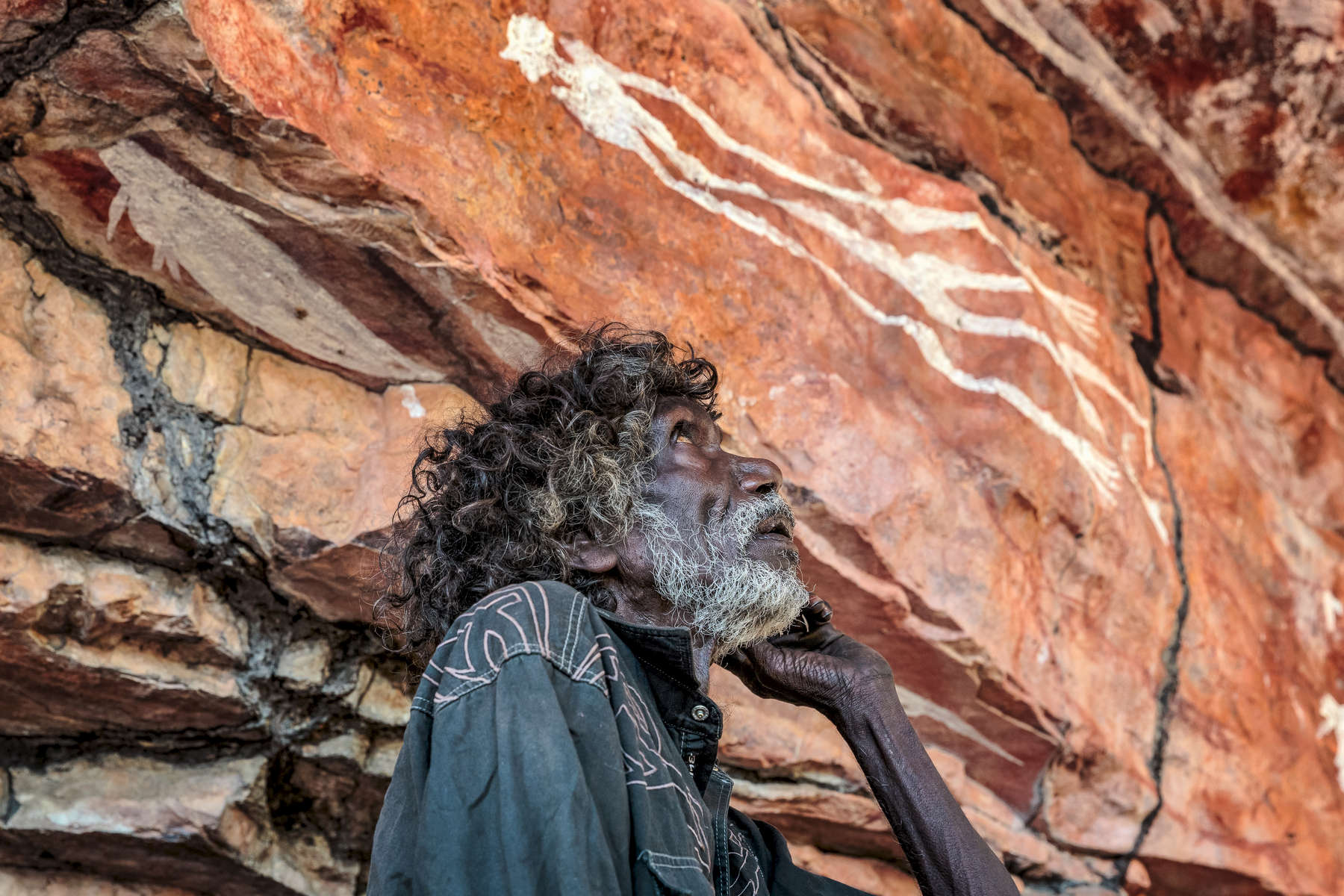 Tom Noytuna, one of the last hunter gathers in Arnhem Land, at a rock art site named Dukaladjarranj.  Many of the paintings here were created by Tom's father, Mandarg