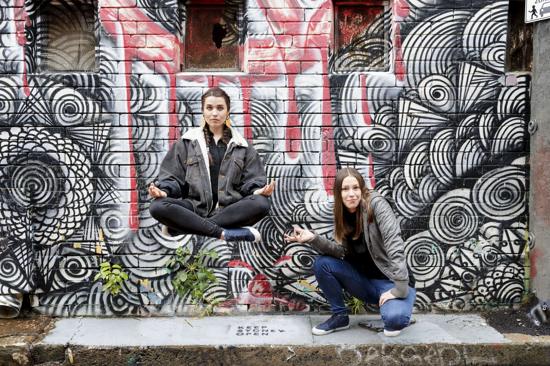 Erica (floating) and Sally of the hip hop group Coda Conduct  in May Lane, St.Peters on July 08, 2016.  Photo: Brook Mitchell