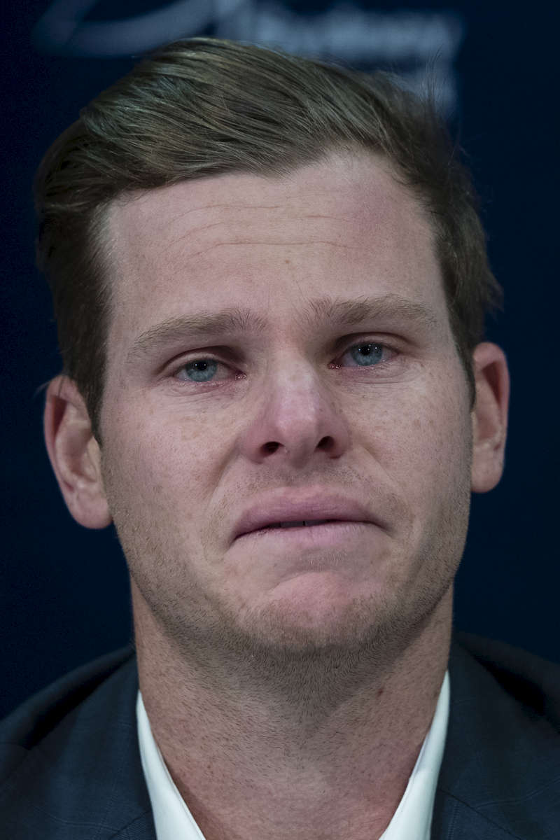 SYDNEY, NEW SOUTH WALES - MARCH 29:  Steve Smith is comforted by his father Peter during a press conference at Sydney International Airport on March 29, 2018 in Sydney, Australia. Steve Smith, David Warner and Cameron Bancroft were flown back to Australia following investigations into alleged ball tampering in South Africa.  (Photo by Brook Mitchell/Getty Images)