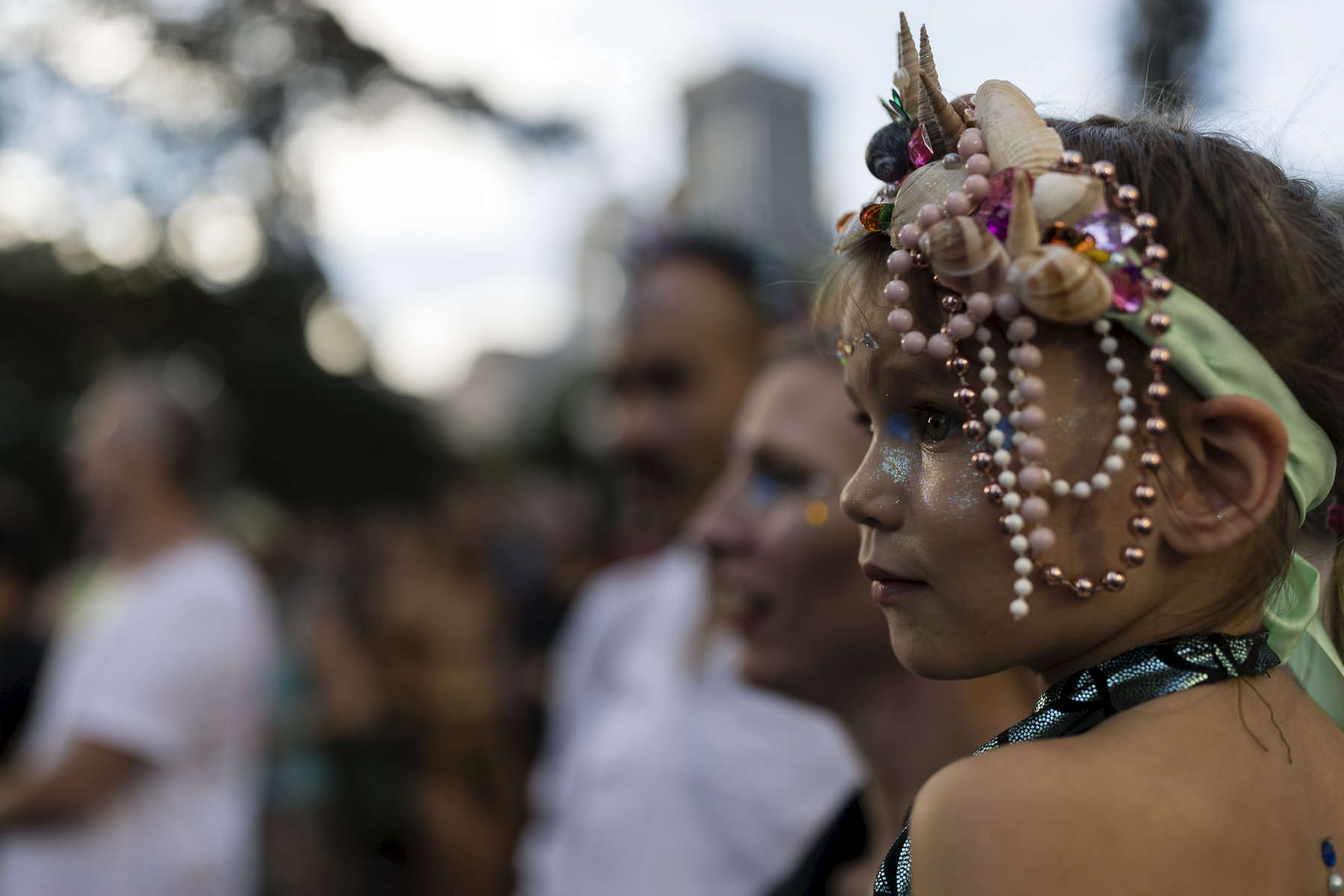 SYDNEY, NEW SOUTH WALES - MARCH 03: A young girl watches on during the 2018 Sydney Gay & Lesbian Mardi Gras Parade on March 3, 2018 in Sydney, Australia.  The Sydney Mardi Gras parade began in 1978 as a march and commemoration of the 1969 Stonewall Riots of New York. It is an annual event promoting awareness of gay, lesbian, bisexual and transgender issues and themes.  (Photo by Brook Mitchell/Getty Images)