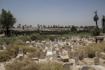 11/08/2016 -- Baghdad, Iraq -- When Baghdad's station was built by the British in the 1950s, an ancient graveyard had to be split into two to make way for the tracks. Today, as well as being a graveyard people who have passed away, we can see trains lying derelict nearby.