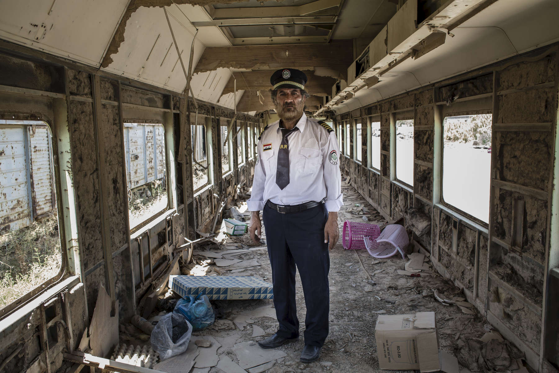 11/08/2016 -- Baghdad, Iraq -- A portrait of Ali Al-Karkhi inside one of the looted trains. Al-Karkhi explains that when he saw the trains being looted, he felt like bits of his body were being cut off.