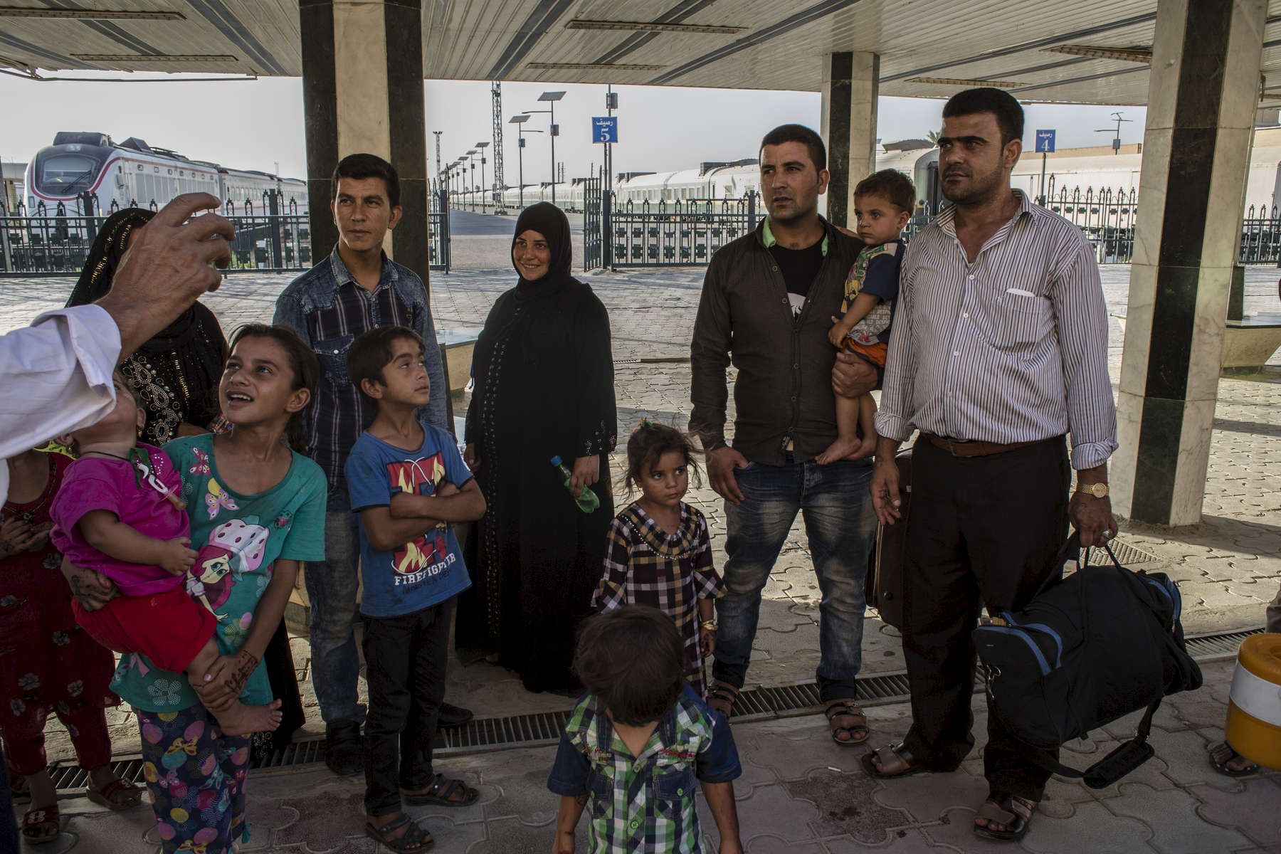 11/08/2016 -- Baghdad, Iraq -- A family of IDPs from Mosul are returning to Basra by train, their new home since fleeing ISIS, after visiting family in Baghdad.