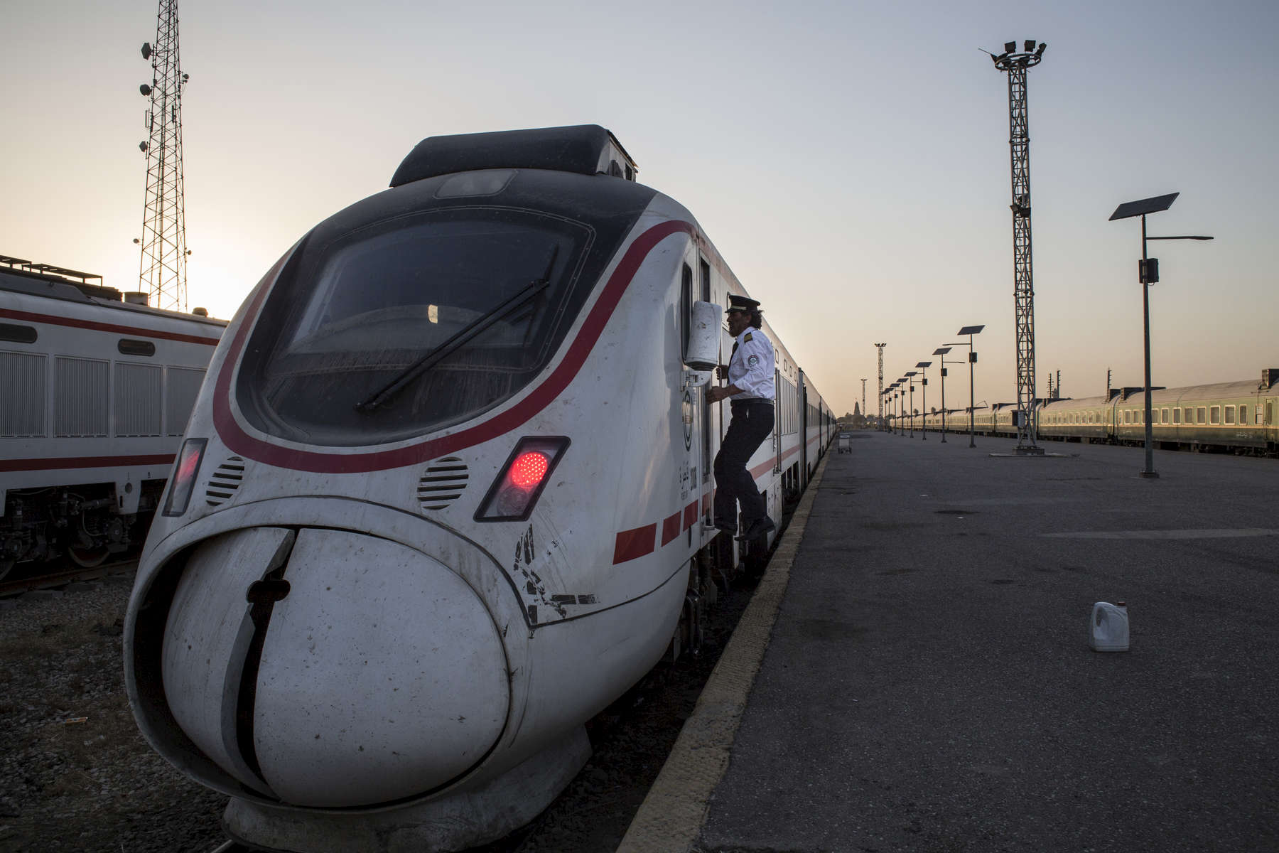 11/08/2016 -- Baghdad, Iraq -- At sunset, Ali Al-Karkhi boards the train for a final inspection before it embarks on the 10 hour journey to Basra from Baghdad.