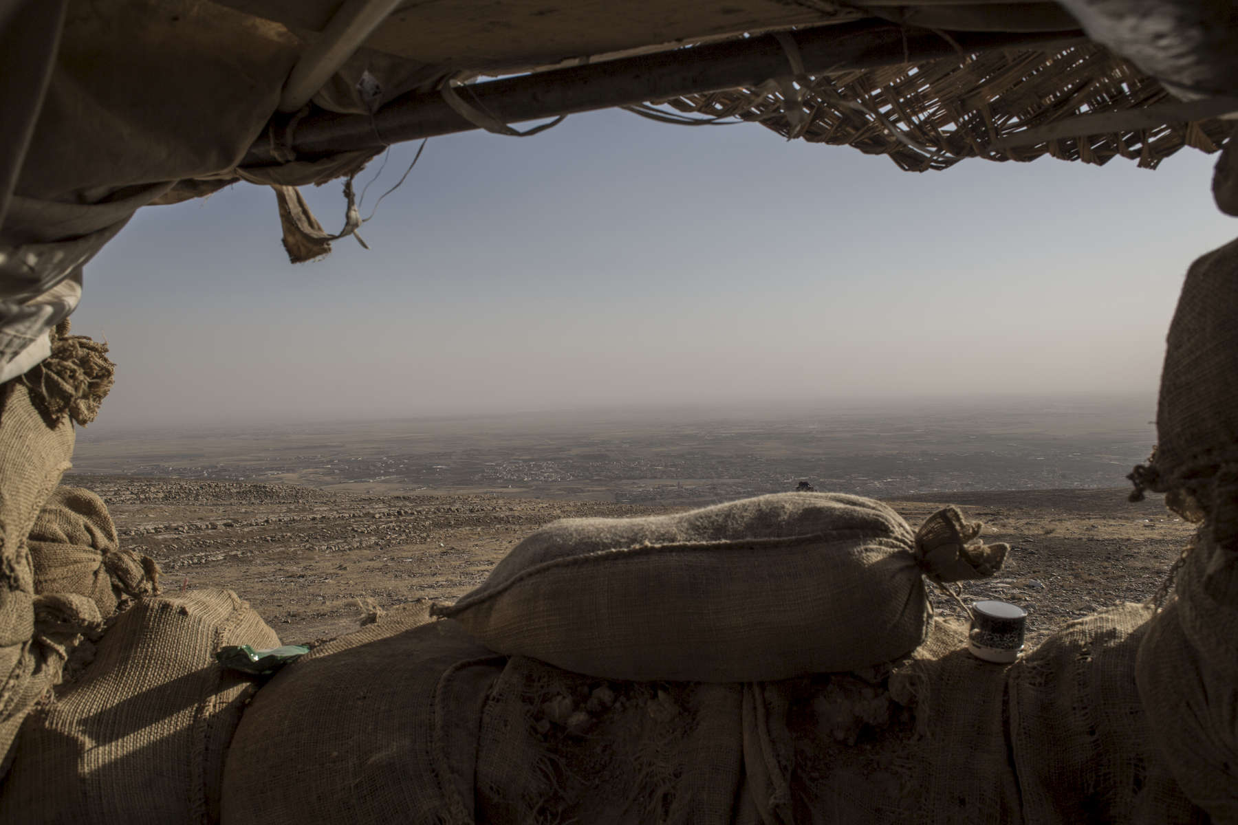 01/09/2016 -- Bashika, Iraq -- A Peshmerga frontline position looks out on the ISIS-occupied town of Bashiqa, one of dozens that remains to be retaken before the assault on Mosul can begin.