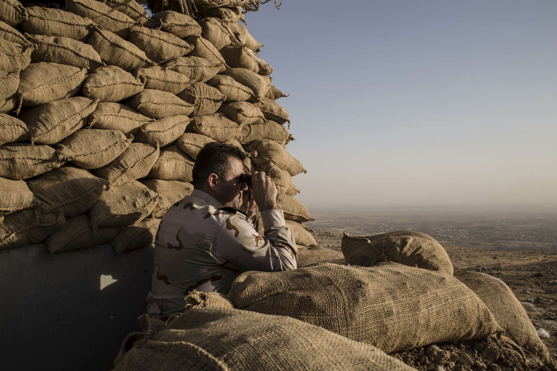 01/09/2016 -- Bashika, Iraq -- A Peshmerga fighter have occupied static positions overlooking the town of Bashiqa for over two years.
