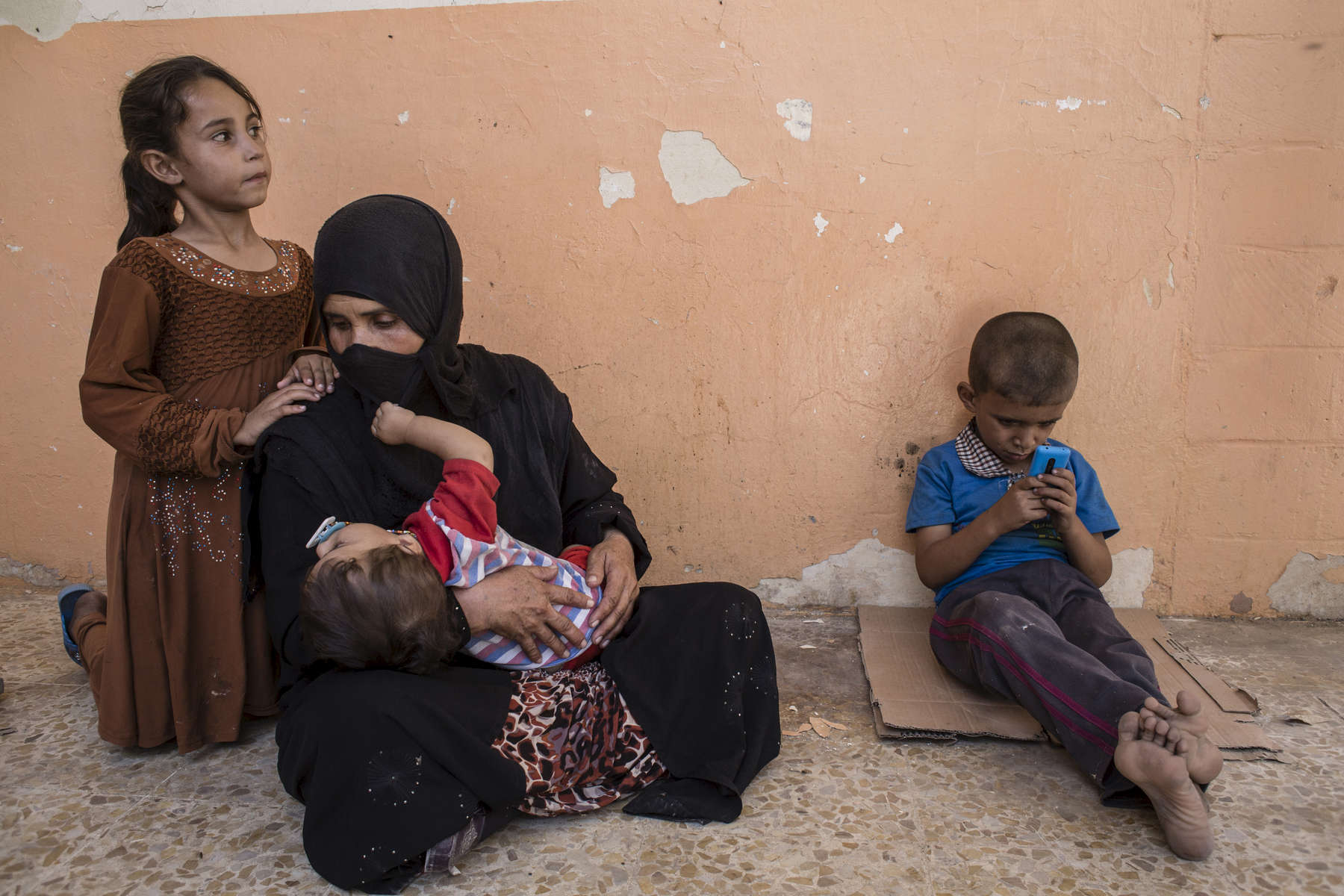 02/09/2016 -- Haji Ali Village, Iraq -- Iraqi women and children at a temporary displacement camp in Haji Ali. Local NGOs have provided basic food items but international NGOs consider the area to dangerous to operate in.