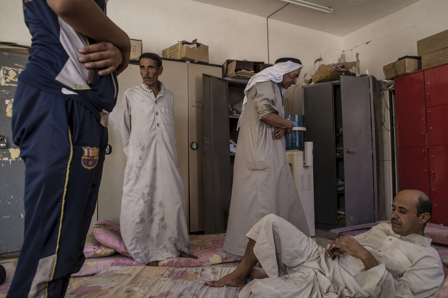 02/09/2016 -- Haji Ali Village, Iraq -- Iraqi men prays at a temporary displacement camp in Haj Ali.