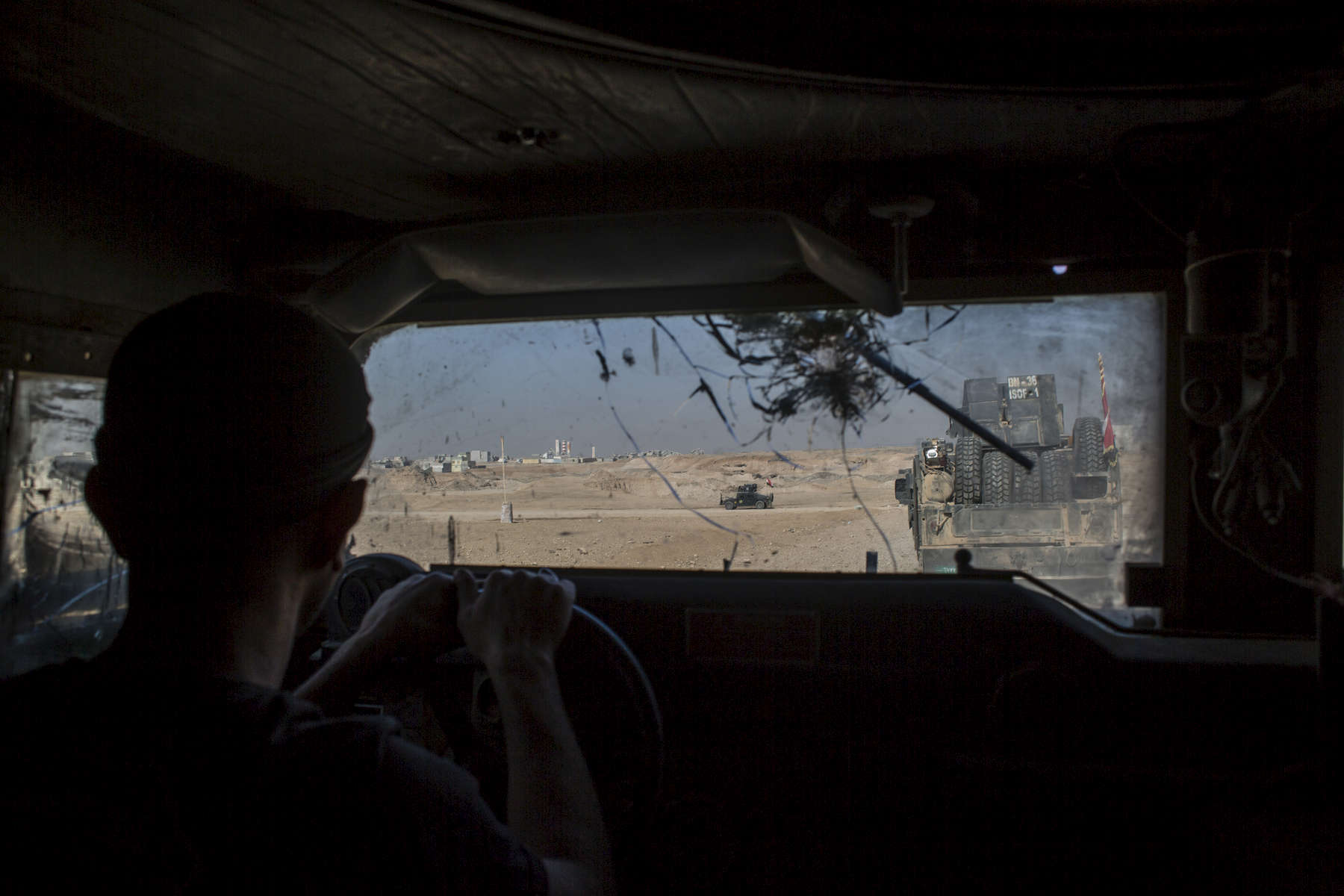 05/11/2016 -- Mosul, Iraq -- On the way to the frontline with Iraqi special forces. Most of the Iraqi Humvees have been hit by ISIS snipers.