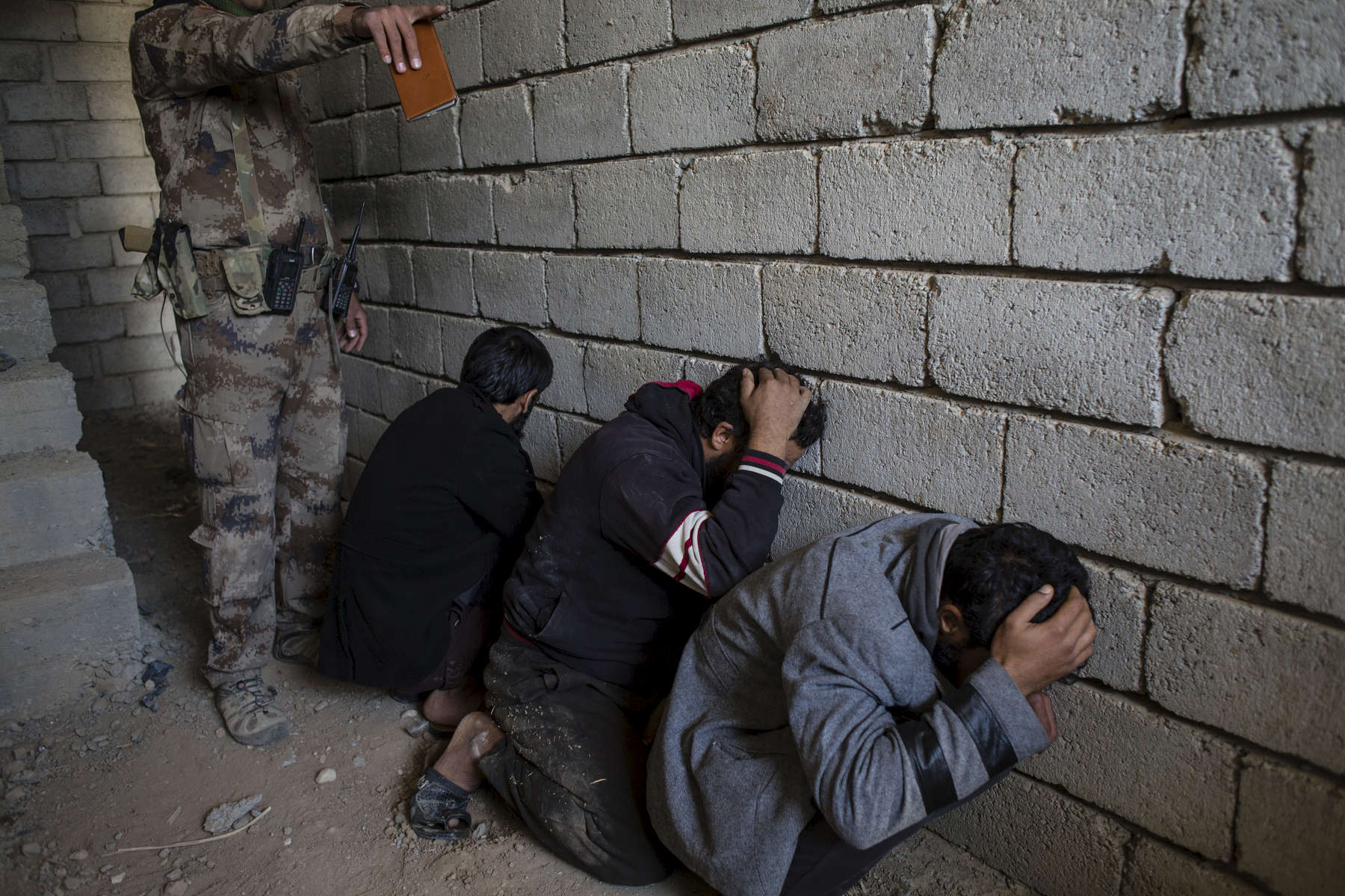 06/11/2016 -- Mosul, Iraq -- Three Suspect ISIS arrested by Iraqi special forces while they were searching for suspected ISIS in the houses in the liberated area.