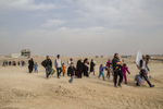 08/11/2016 -- Mosul, Iraq -- Iraqi families from Mosul leaving their houses after Iraqi special forces liberated the neighbourhoods in east of Mosul.