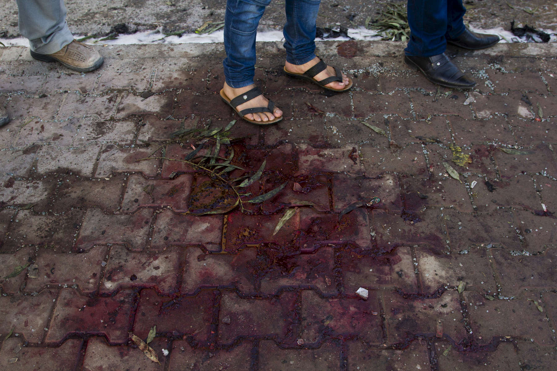 25/06/14, Kirkuk, Iraq -- Blood on the pavement at the site of a suicide bombing in Kirkuk which killed 5 people and wounded other 19 earlier in the afternoon. Rahimawa neighbourhood is a Kurdish area.
