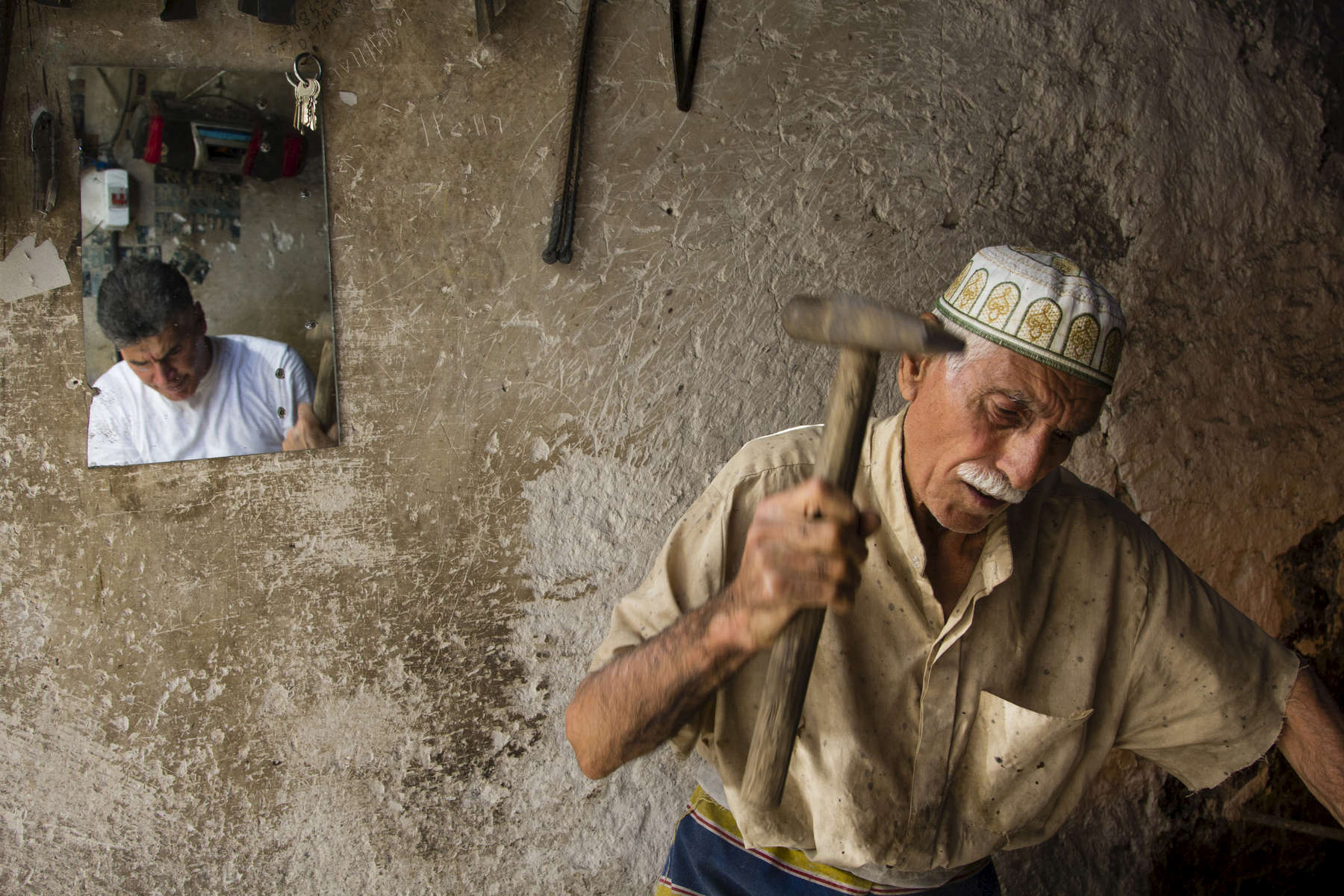 09/08/2014 -- Kirkuk -- Murad Mustafa 38 years old works with his father Mustafa Mohamad 75 years old who have been a black smith for 58 years - in their workshop in Garage Hawija.