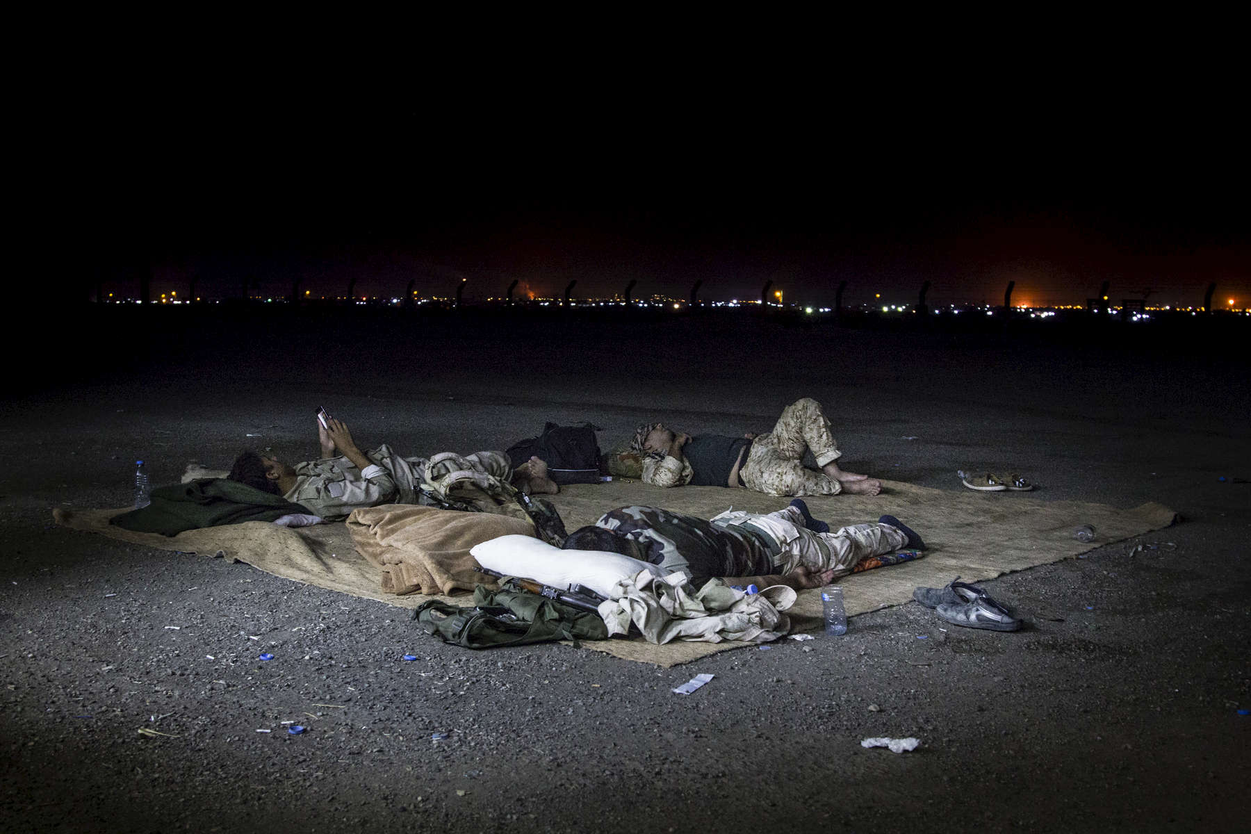 KIRKUK, IRAQ: Peshmerga sleep outside at Maktabi Khalid Peshmerga base on the outskirts of Kirkuk.Peshmerga are the Kurdish military forces. Those based at Maktabi Khalid play both support and combat roles in the conflict with Sunni militants led by the Islamic State of Iraq and al-Sham, who recently took all but 50km of the territory that borders the semi-autonomous region of Iraq Kurdistan.Credit: Hawre Khalid/Metrography