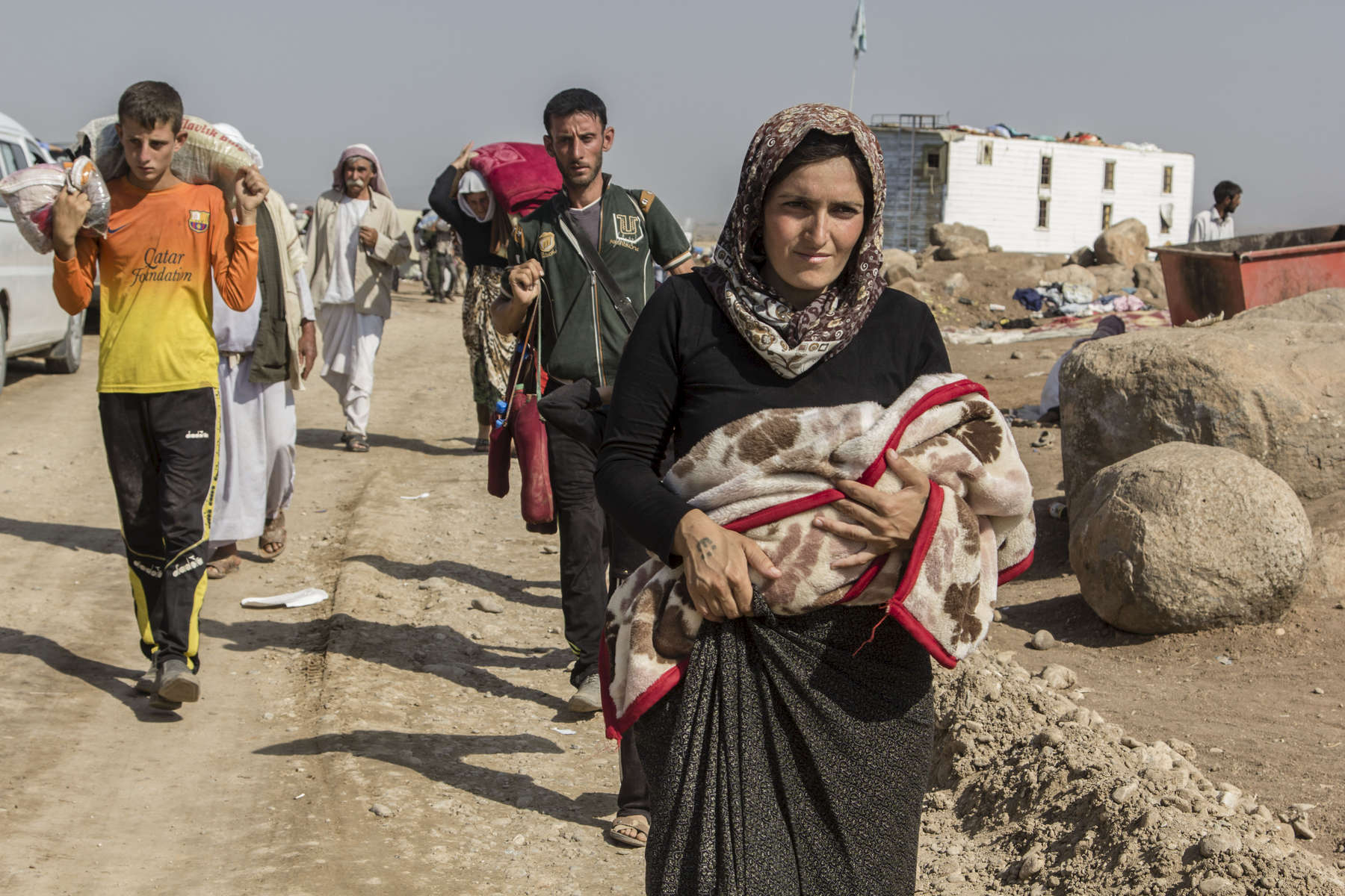 14/08/2014 -- Newroz Camp, Dirk, Syria -- Yazidi people reach Newroz camp after a long way from Sinjar mountain.