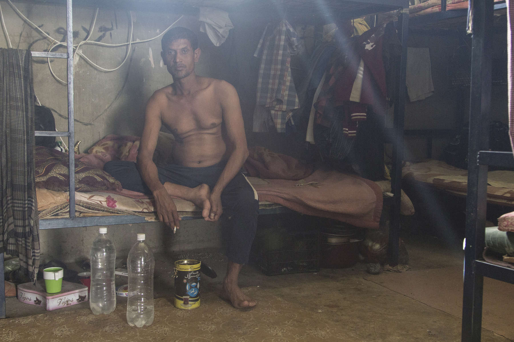 10/10/2014 -- Kirkuk, Iraq -- A Bangladeshi worker on his bed in the shared room where he lives.