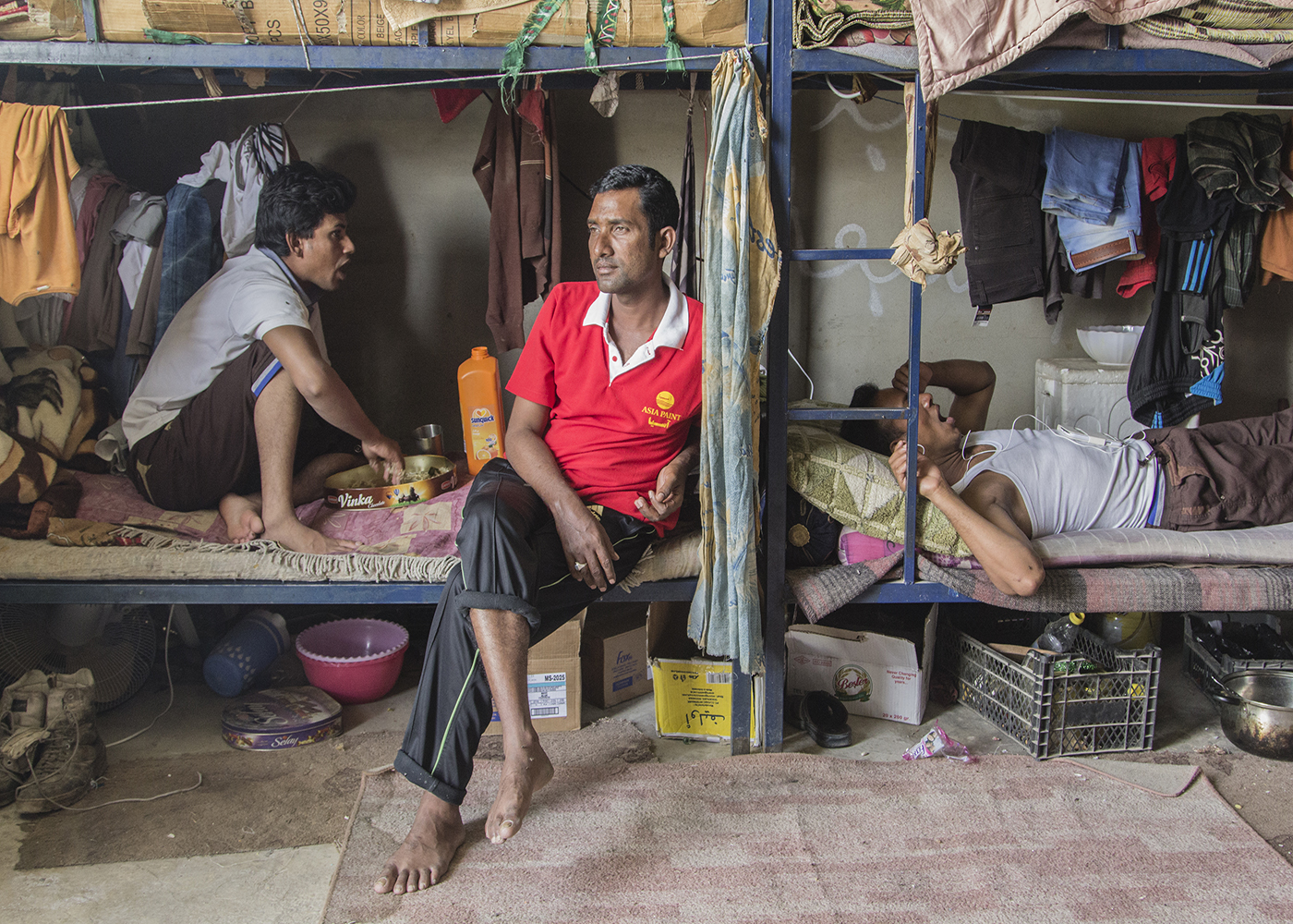 10/10/2014 -- Kirkuk, Iraq -- A portrait of Bangladeshi worker in his bedroom in the afternoon when they have 2 hours rest.