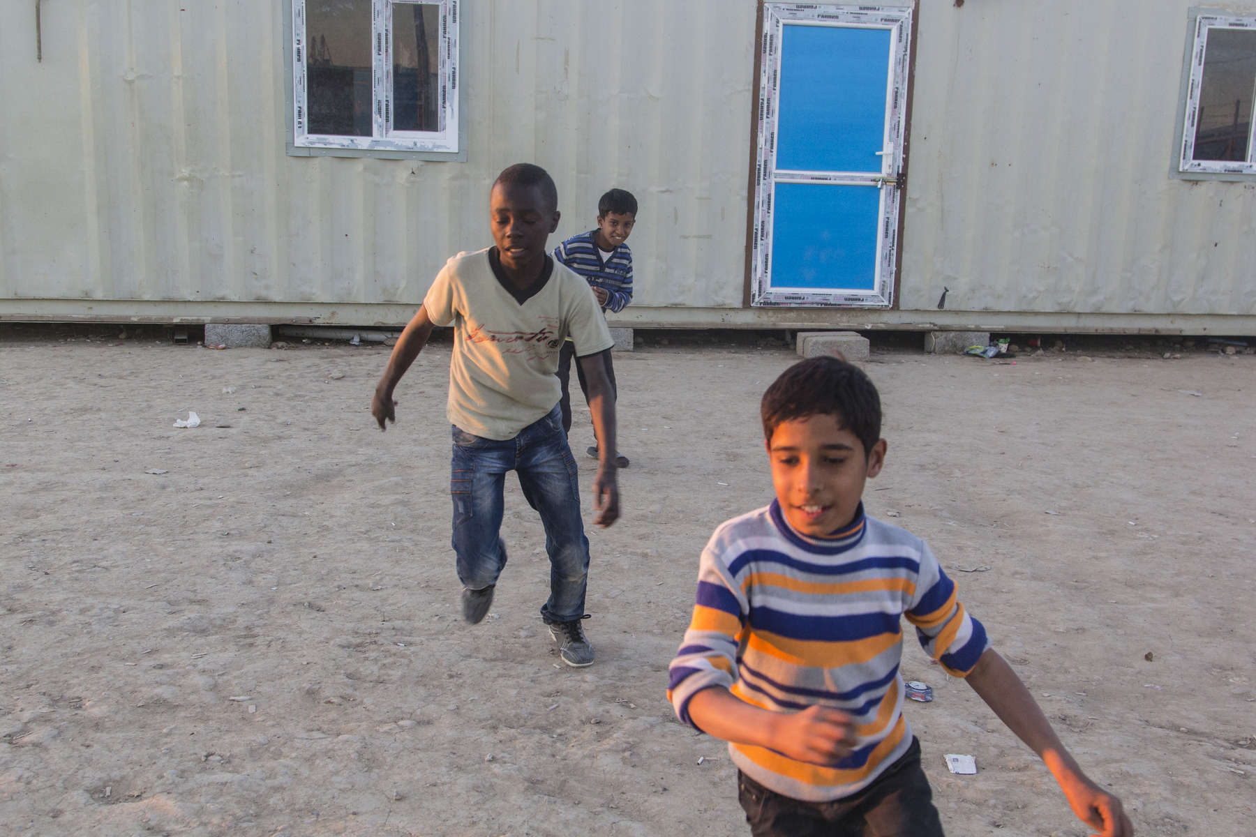 20/01/2015 -- Kirkuk, Iraq -- Omer playis football with his friends on the camps ground.