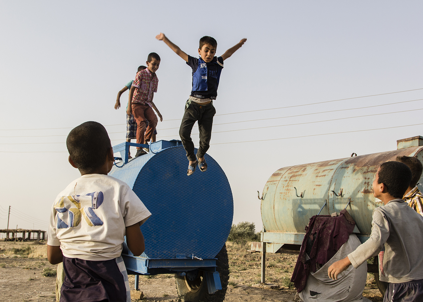 04/07/2015 -- Dibaga-Makhmur-, Iraq -- IDP kids jump from the tank of water as a game in Dibaga.