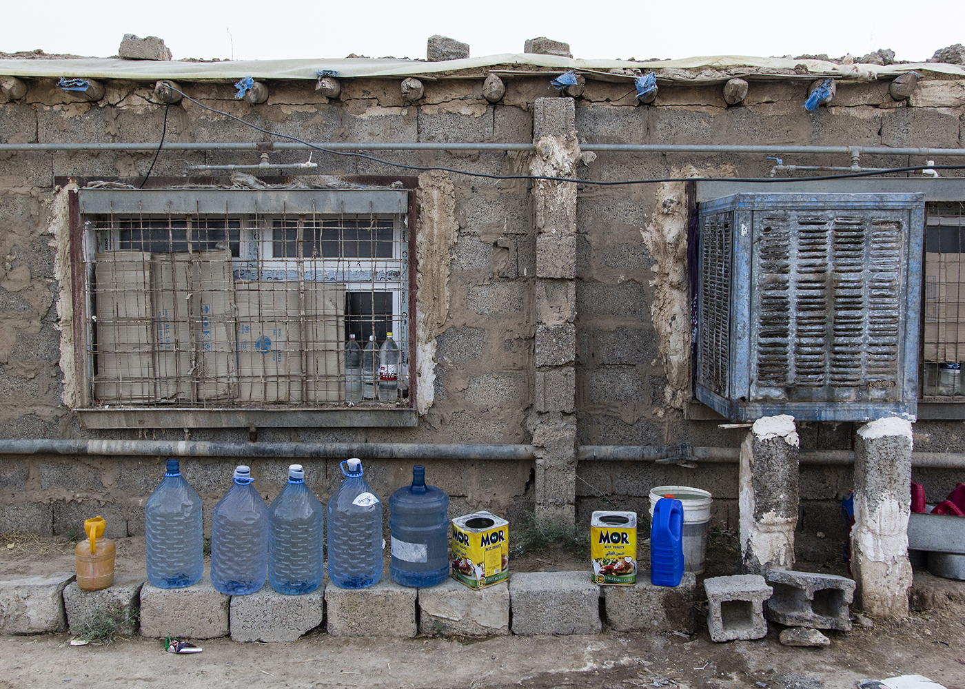 04/07/2015 -- Dibaga-Makhmur-, Iraq -- IDP people keep Some bottel's of water in front of there houses to take shower with.