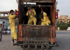 10/10/2014 -- Kirkuk, Iraq -- Bangladeshi workers in the trash car go to clean the streets.