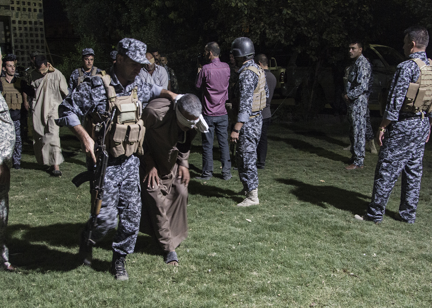 25/10/2015 -- Kirkuk-Iraq, Iraq -- Police bring an ISIS suspect in police base to prison when he arrested during the raid to looking for ISIS members in Chardakhlo village in south of Kirkuk.