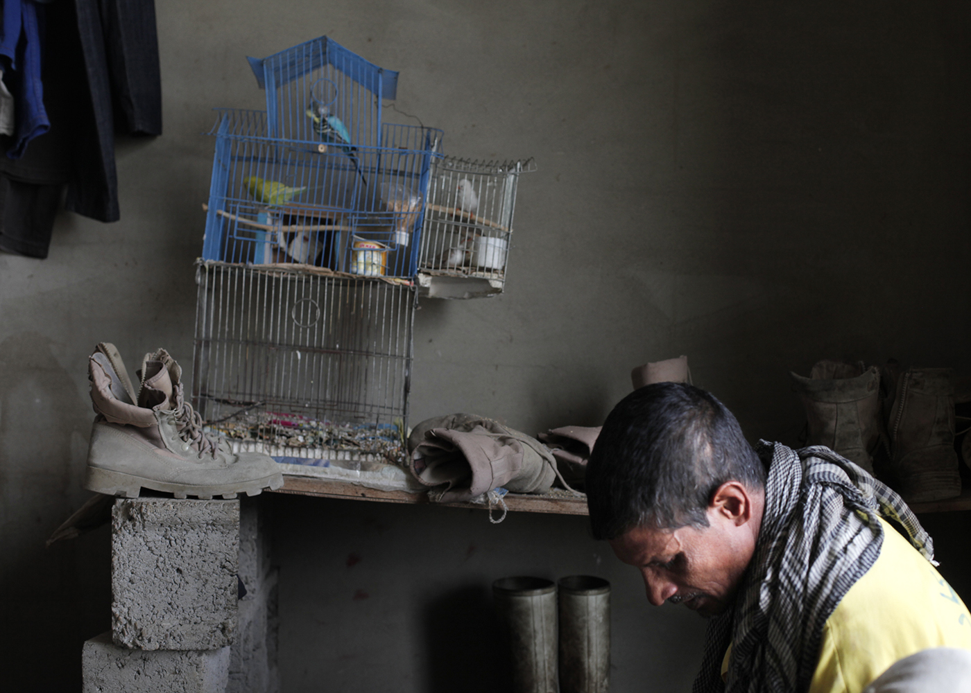 10/10/2014 -- Kirkuk, Iraq -- Birds cage inside a room of Bangladeshi workers in the garage where they live in on the Kornish street in Kirkuk north of Iraq.