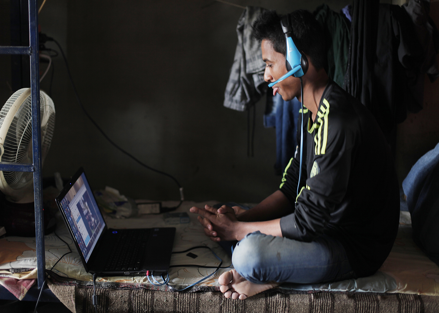10/10/2014 -- Kirkuk, Iraq -- A Bangladeshi worker talk to his family via Skype in the garage on Kornish street.