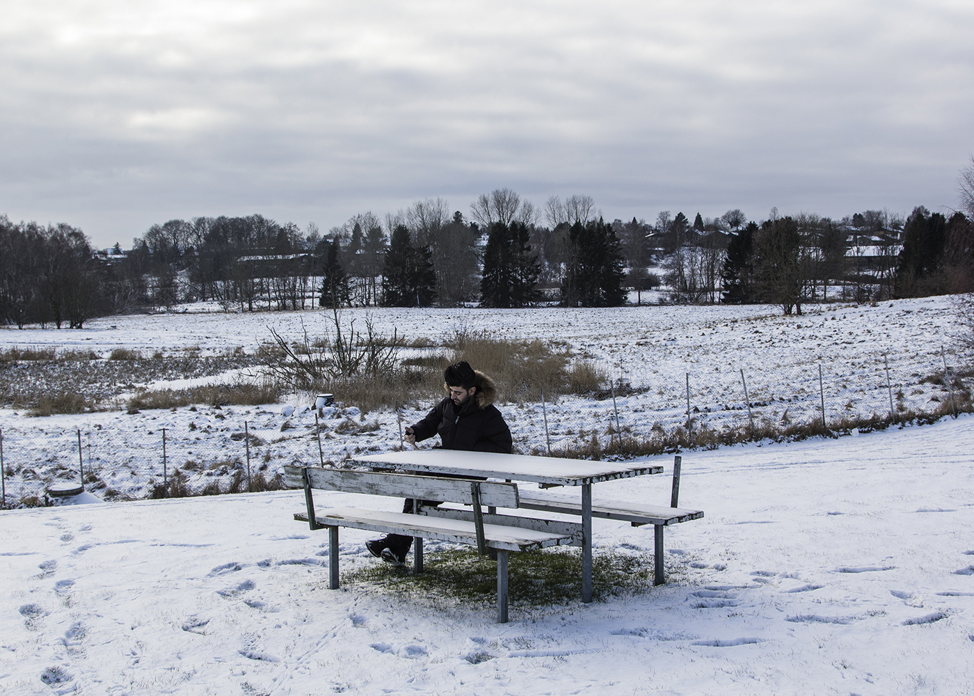 15/01/2016 -- Sandholm, Denmark -- Qanie sit alone in the snowing weather in the Sandholm refugee camp in Denmark.