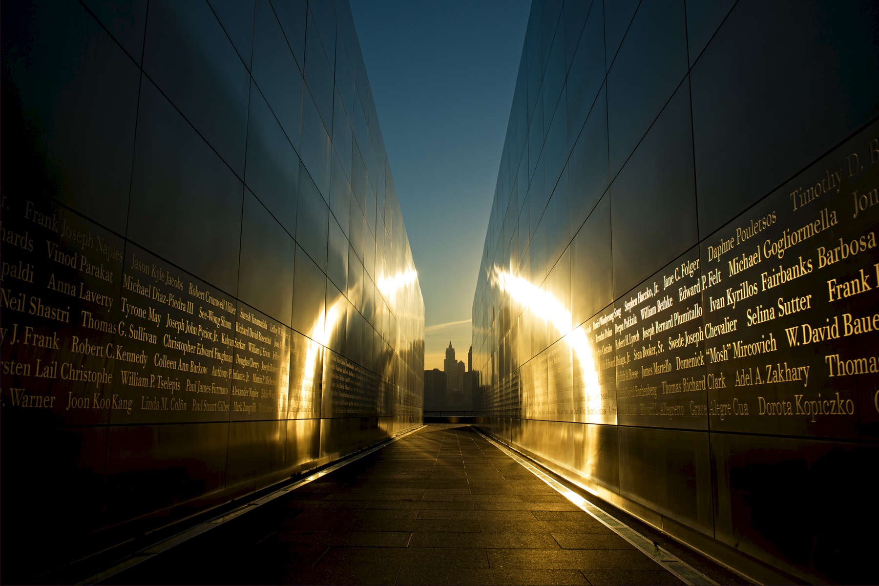 Liberty State Park, New Jersey, USA.Role + Responsibility: Designed by Jessica Jamroz and Frederic Schwartz, the Empty Sky Memorial design was shortlisted by a jury of professional peers and unanimously selected by the NJ 9/11 Memorial Foundation as the winning entry in an open international design competition. The memorial commemorates 749 people from the State of New Jersey who were killed during the September 11, 2001, attacks.As Memorial designer and Director of design and construction of the memorial, Jessica imagined and orchestrated all aspects of the memorial design and its construction from conception through fruition. The project has been honored by numerous awards (including, among others, the 2012 Associated General Construction of America Alliant Build America Award; 2012 Faith & Form Sacred Landscape Award; 2012 Global SEGD Design Honor Award; 2005 NY NOW AIA People's Choice Award and 2004 New Jersey AIA Unbuilt Project Honor Award). The Memorial was dedicated on the tenth anniversary of September 11, 2011, with six former Governors and then current Governor Chris Christie. The memorial went through three phases of construction over 5 years with a total construction budget of $12.6 million. The final and largest phase of construction—the construction of the Memorial Walls—went through approvals, shop drawings, fabrication, and erection (from bid to construction) in a short 9-month time period. Not only was construction kept on schedule (hard deadline of the 10th anniversary of 9/11), and the quality kept in line with the design vision, but ultimately the project incurred construction change orders less than 1% of the total construction budget.  Owner: State of New JerseyConstruction Cost: $12,600,000Total Area: 2.6 Acres	Designer:	 Jessica Jamroz and Frederic Schwartz Architect:	 Frederic Schwartz ArchitectsContractor: Hall ConstructionMetal Fabrication: Crystal MetalworksStructural Engineer: ARUPSite / Civil / Geotech / Enviornmental: LANGAN Landscape Architect: Arnold AssociatesLighting Designer: Fisher Marantz Stone Electrical Engineer: Robert Derector AssociatesInteractive Designer: Tender Creative / VSA PartnersGraphic Designer: Alexander Isley Inc.Metallurgy Consultant: Cathrine Houska Cost Consultant: TURNER Construction; VJ Associates
