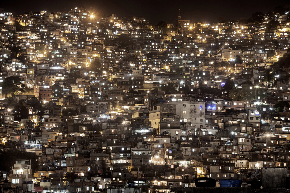A night view of the front side of the Shantytown of Rocinha, in Rio de Janeiro, Brazil, December 4, 2012.With a population of between 120 and 150,000 people, Rocinha is the largest favela in Rio de Janeiro.After being pacified in November 2011, Rocinha remains to be one of the comunities creating more controversy because of its size and its old connections to drug trafficking.While many believe that UPPs have helped quell violence by opening the doors of the favelas to public services such as legal electricity supply, garbage collection, education, public works and social assistance program, others see the pacification program as a temporary cover-up to security problems in Rio de Janeiro.