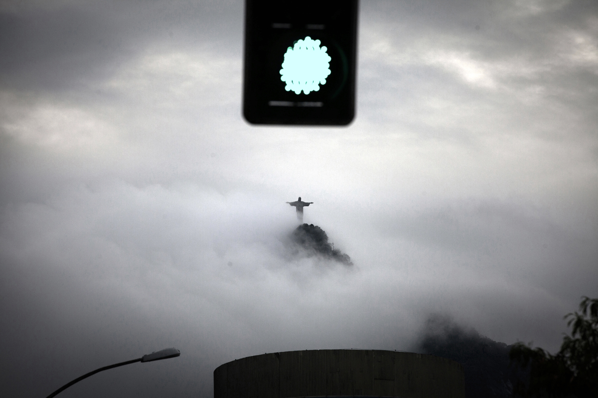 The figure of the Corcovado Christ emerging from the afternoon fog, in Rio de Janeiro, Brazil, December 15, 2011.