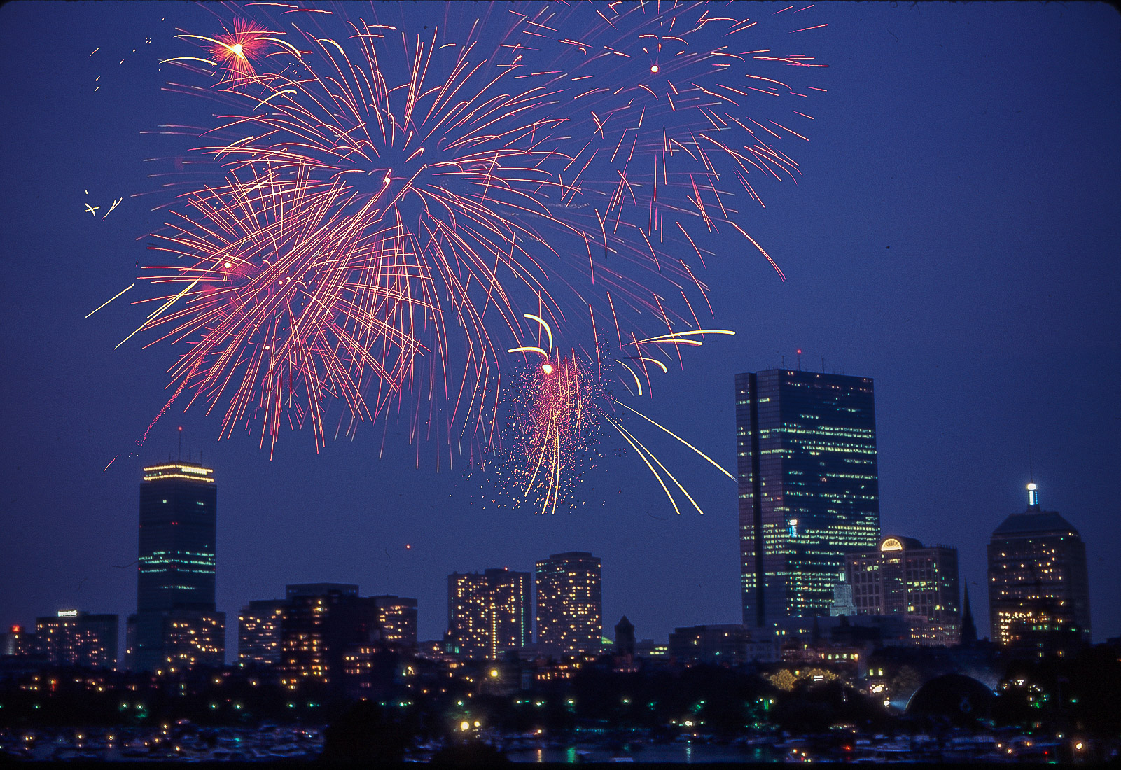 Nighttime Fireworks Panorama Photo of Boston showing Back Bay